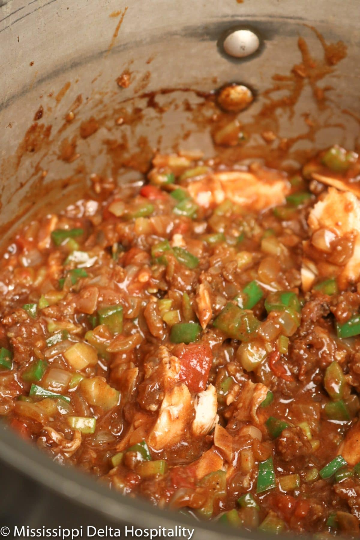 A large stock pot with gumbo.