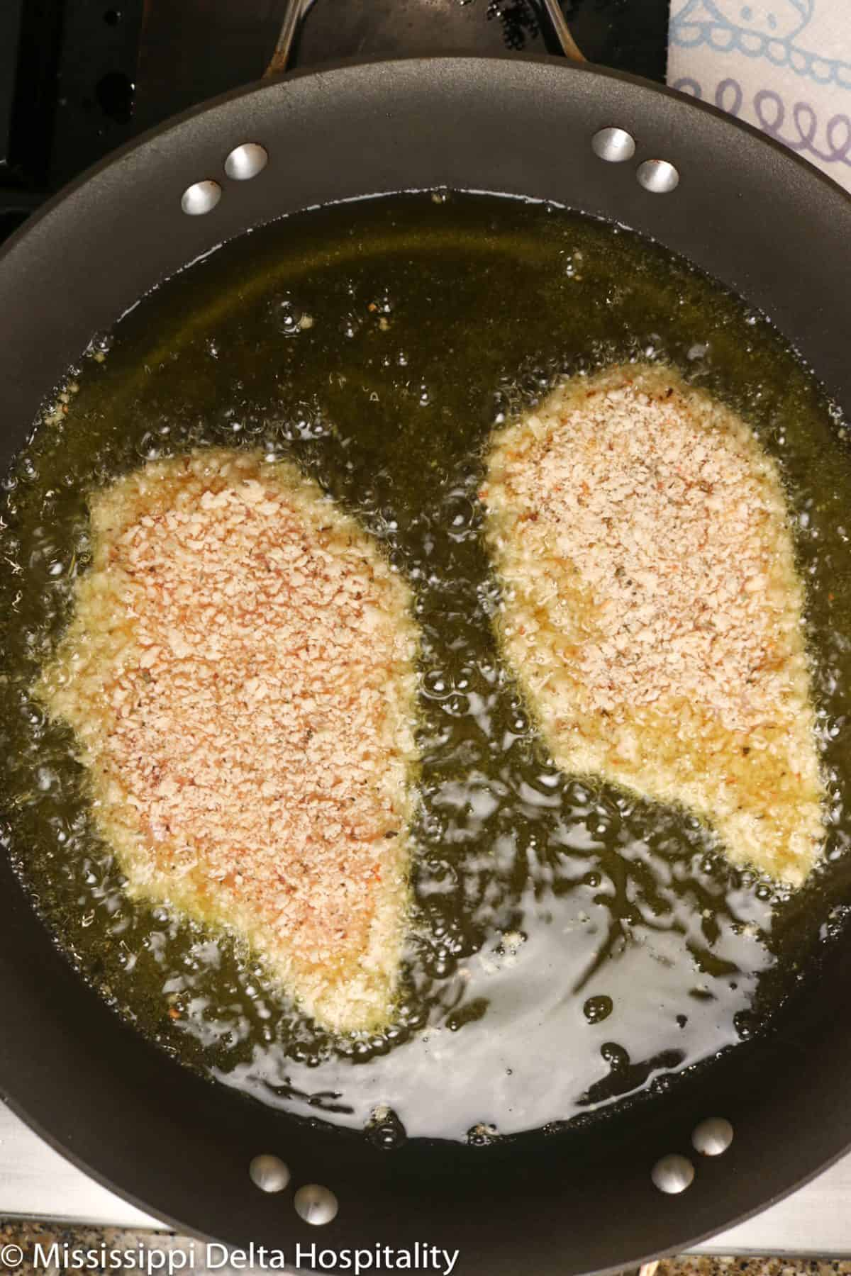 chicken in a pan of oil