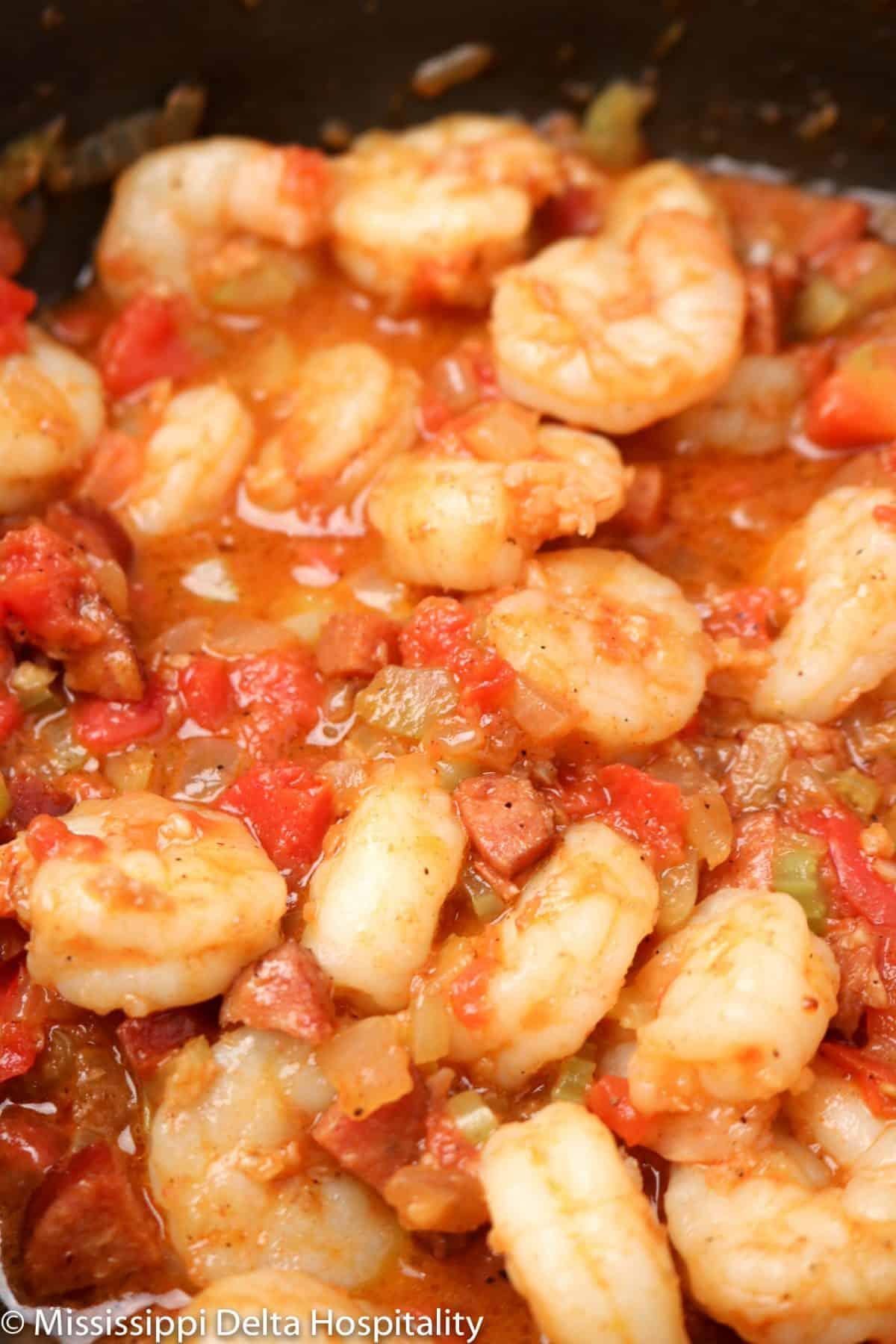 a pot with shrimp creole