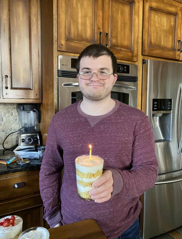 young man (Ian) holding lemon trifle