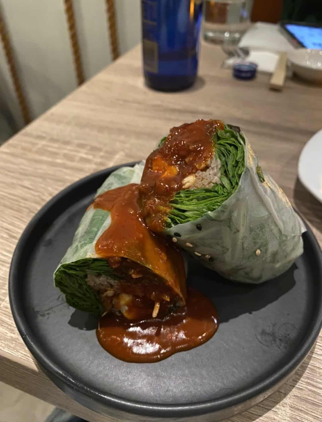 rice paper roll on a black plate
