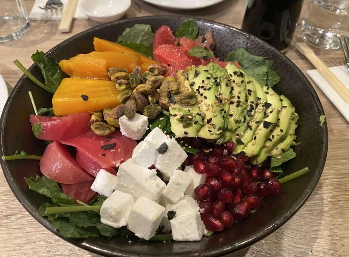 greek salad in a black bowl