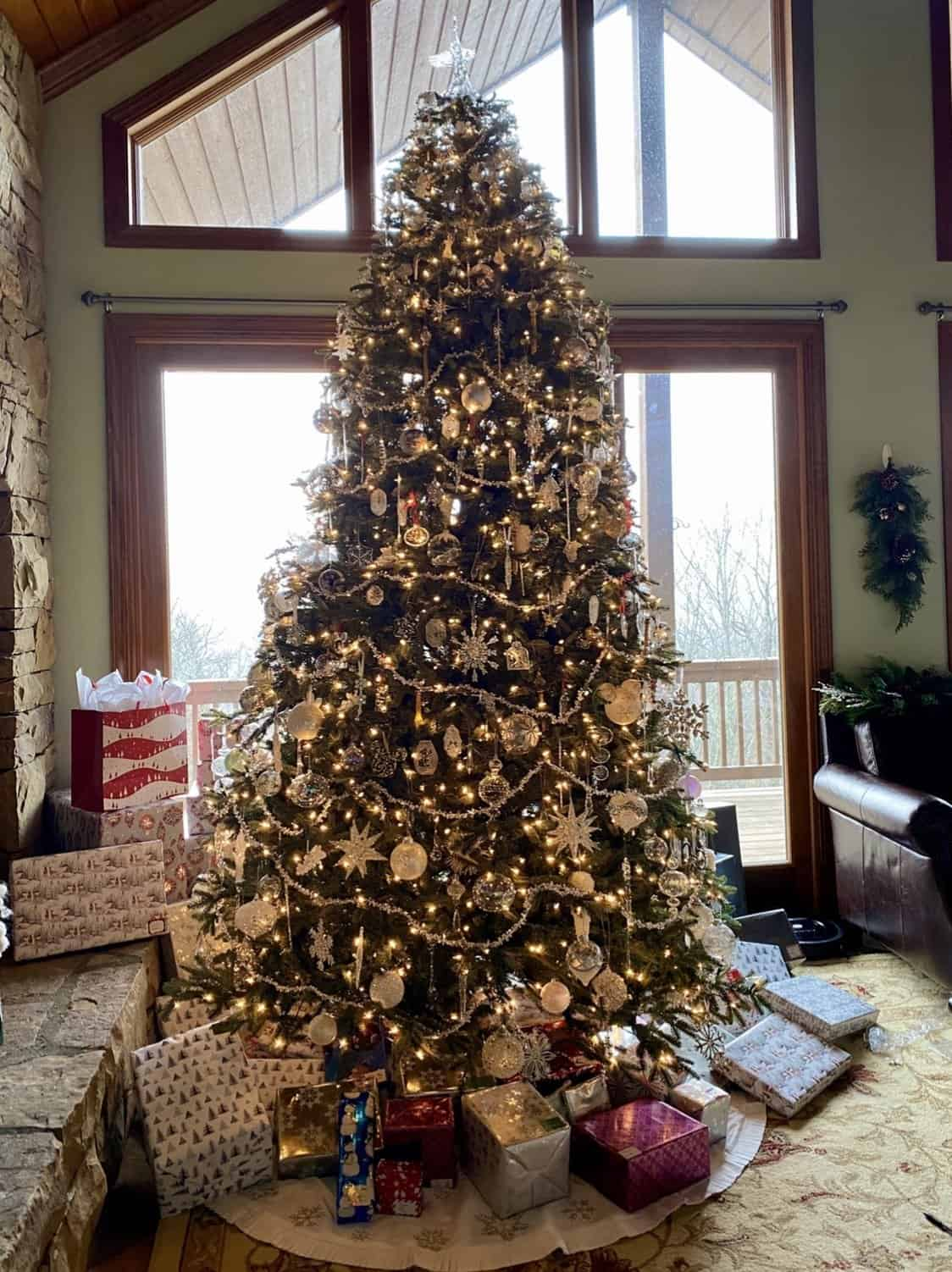 christmas tree with packages under it