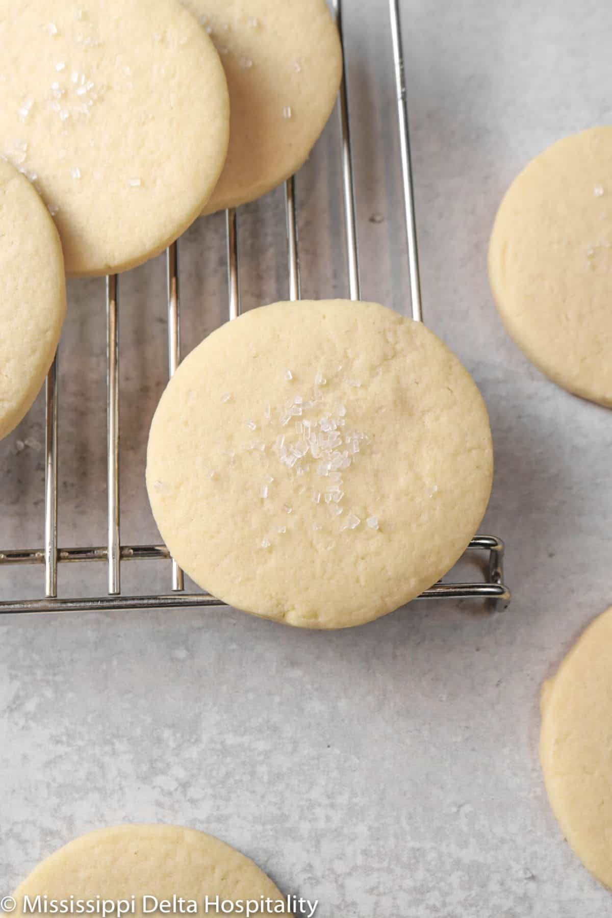 sugar cookies on a cooling rack with white sugar on top