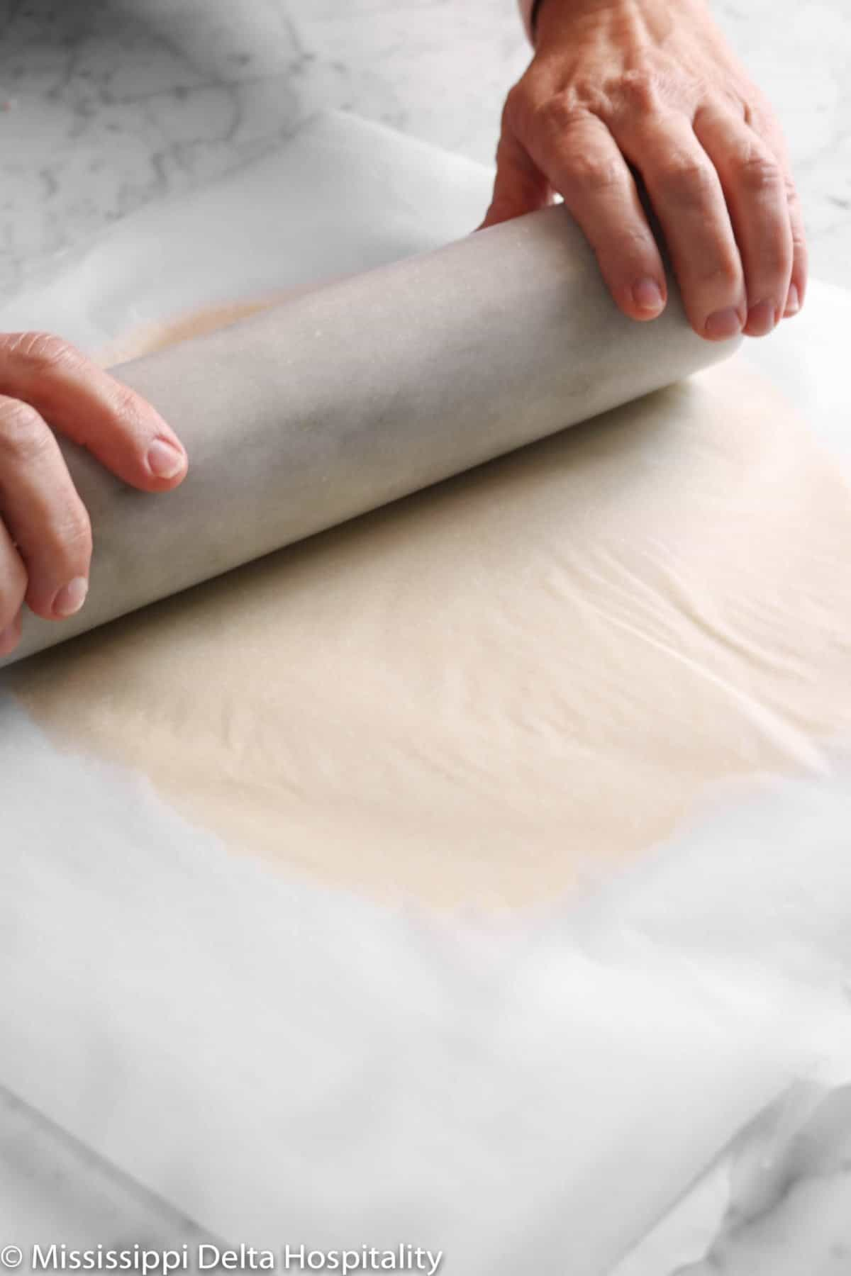 cookie dough being rolled out