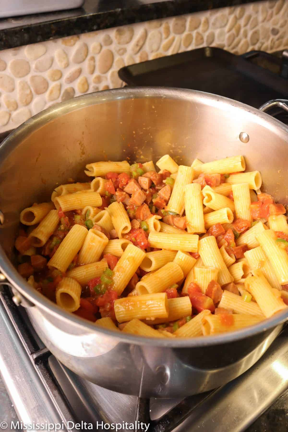 pasta stirred into vegetable and sausage mixture