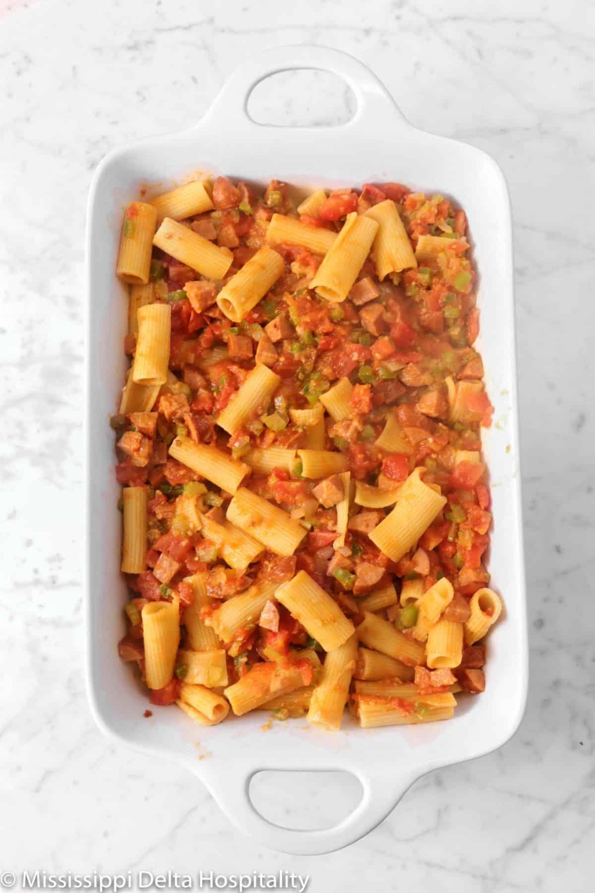 rigatoni mixture in a white casserole dish