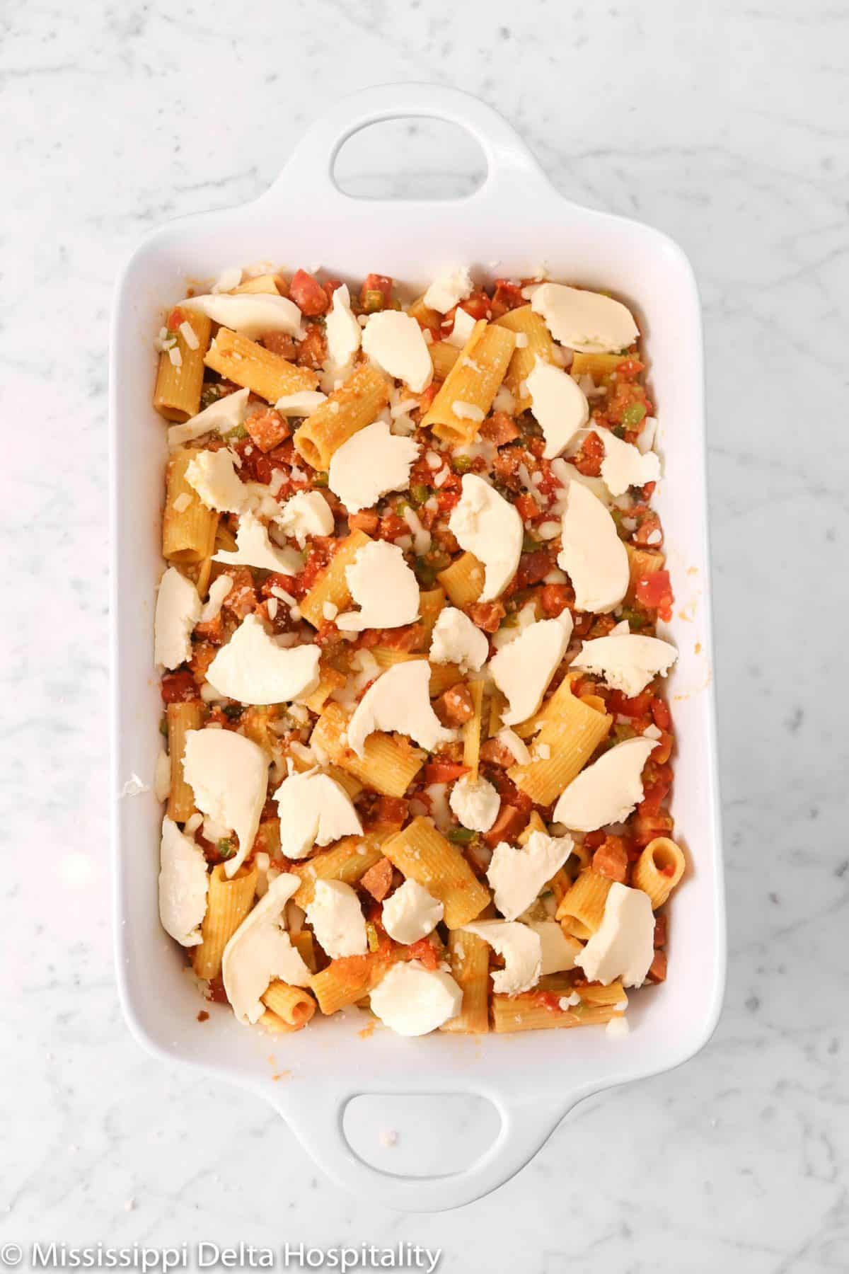 mozzarella cheese added on top of rigatoni mixture