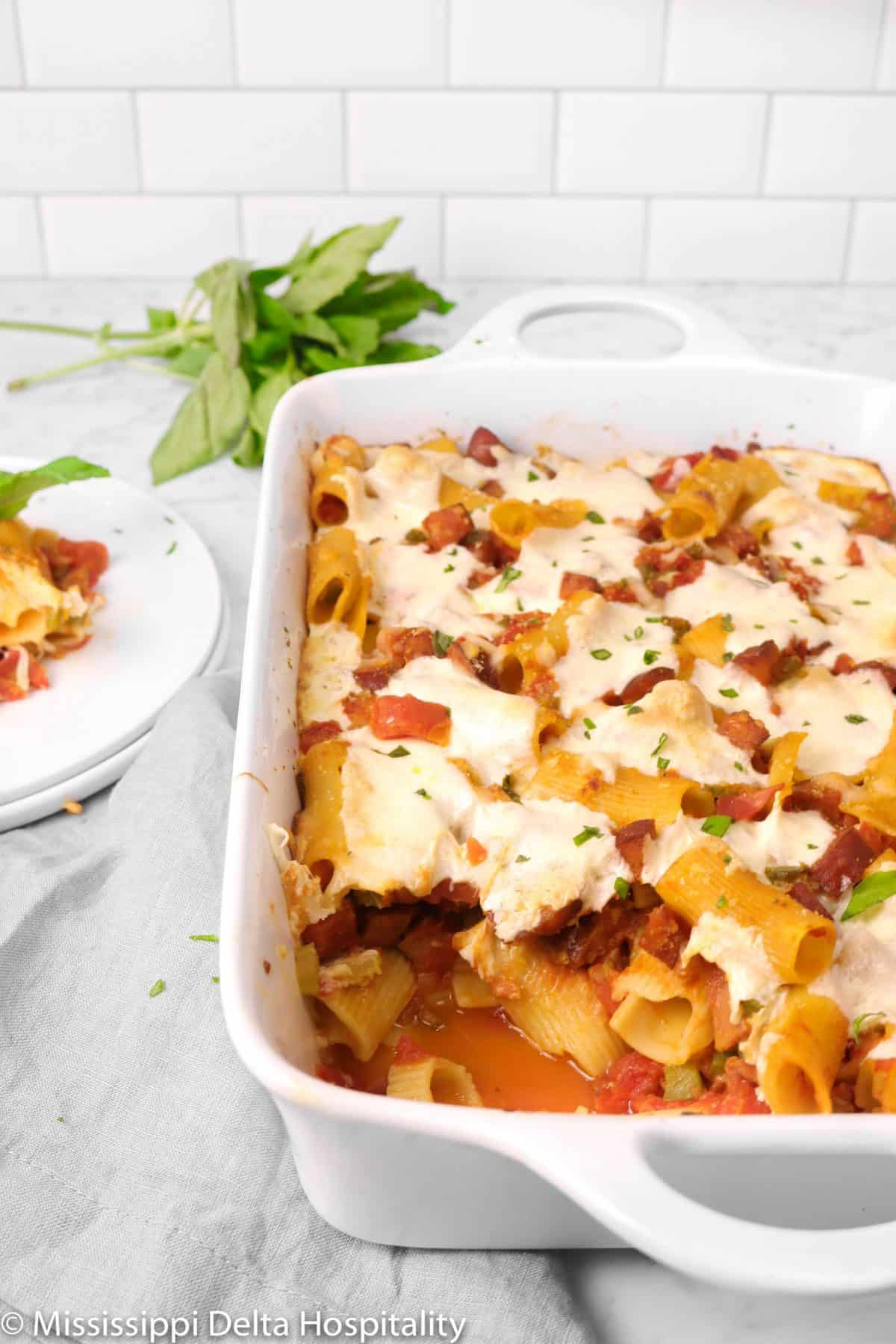 baked rigatoni in a casserole with some scooped out