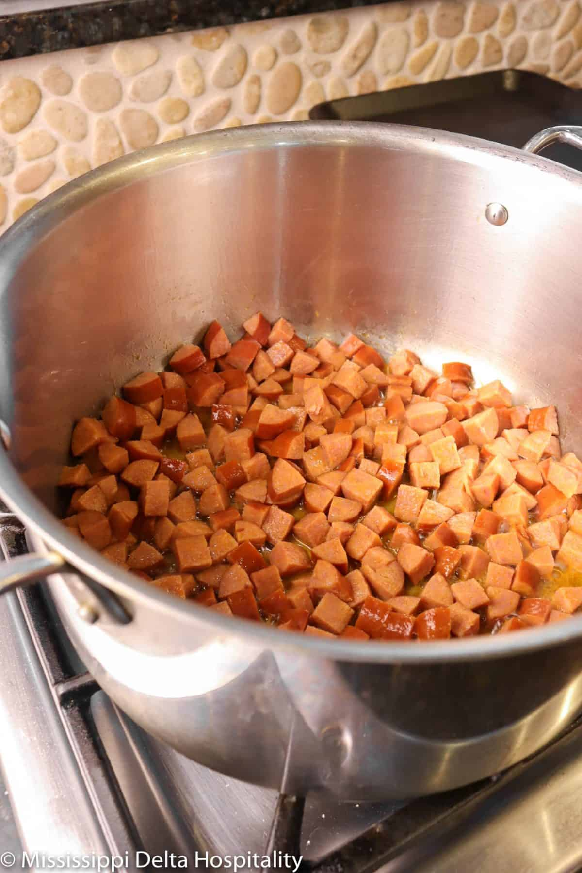 cooked andouille sausage in a pot