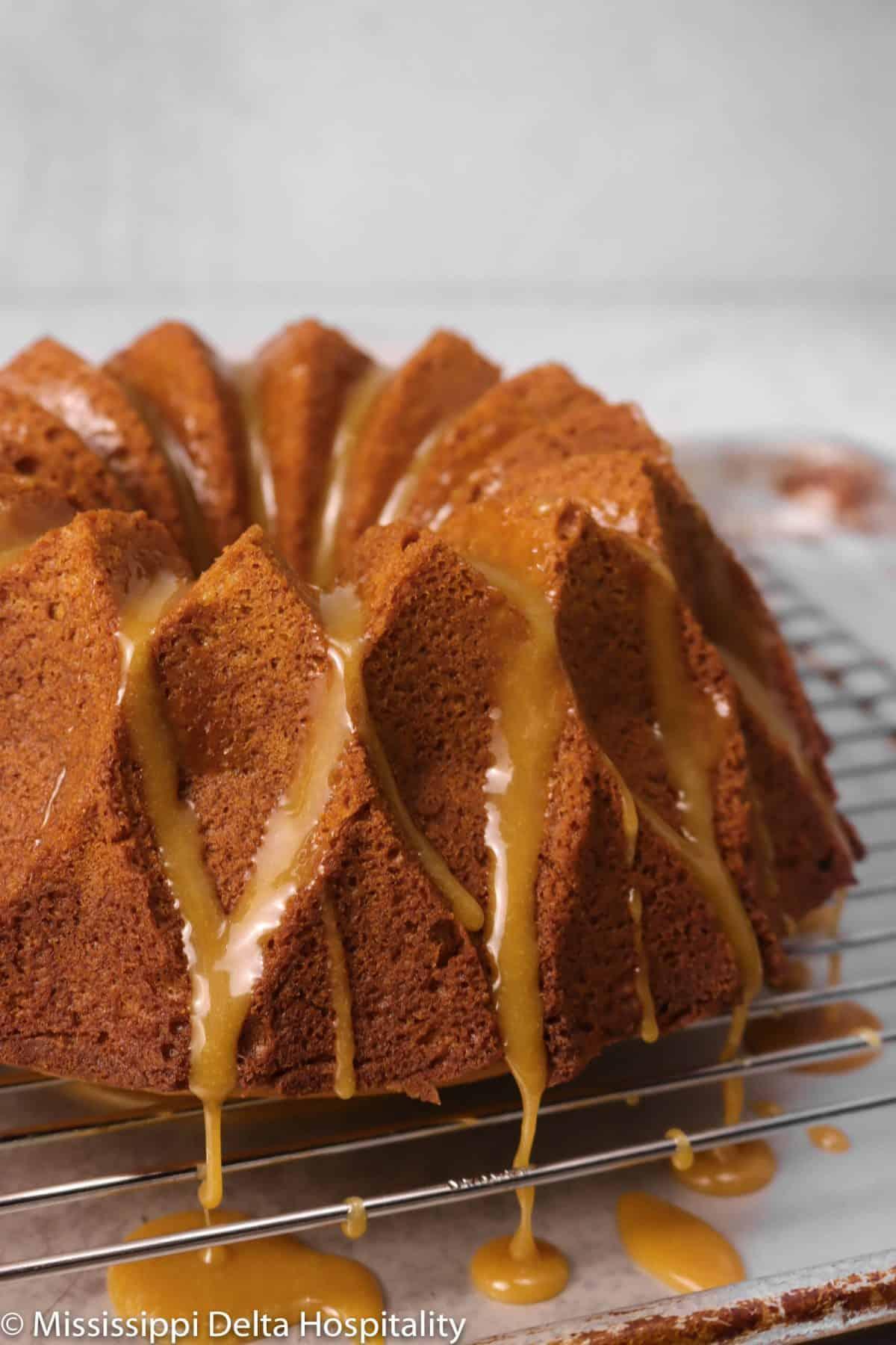 honey cake with honey caramel on a cooling rack
