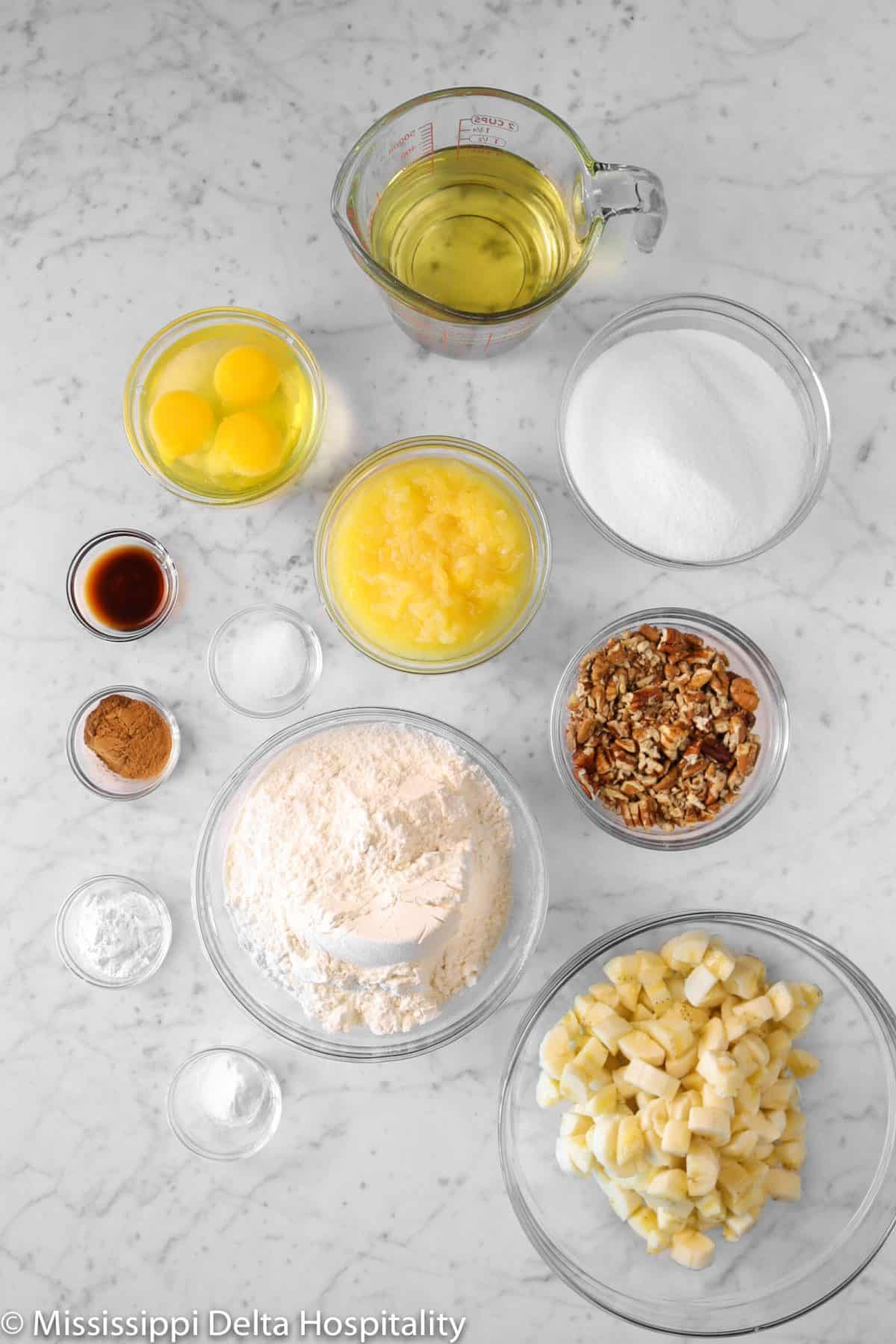 ingredients for hummingbird cake on a marble board