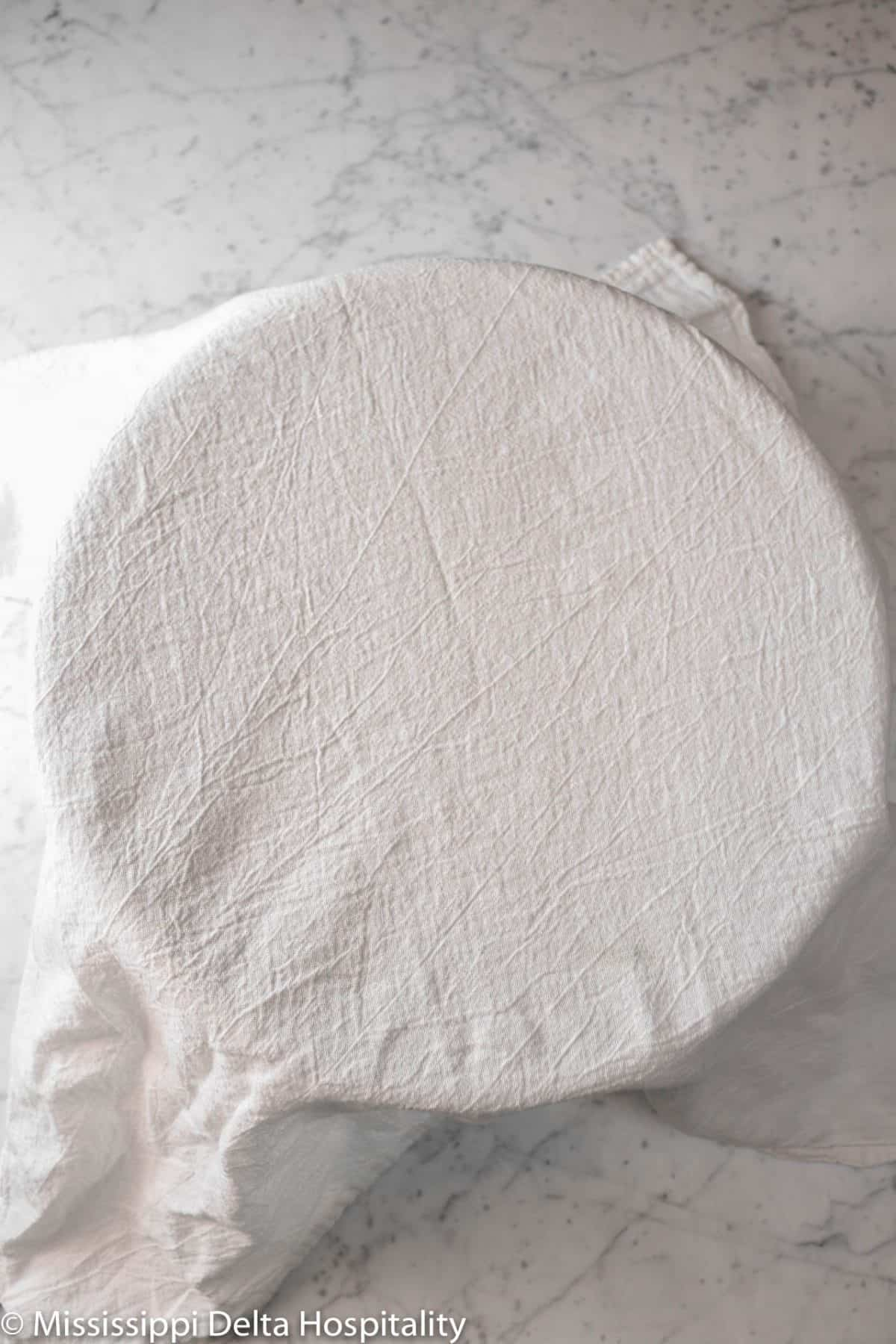 mixture covered with a white towel