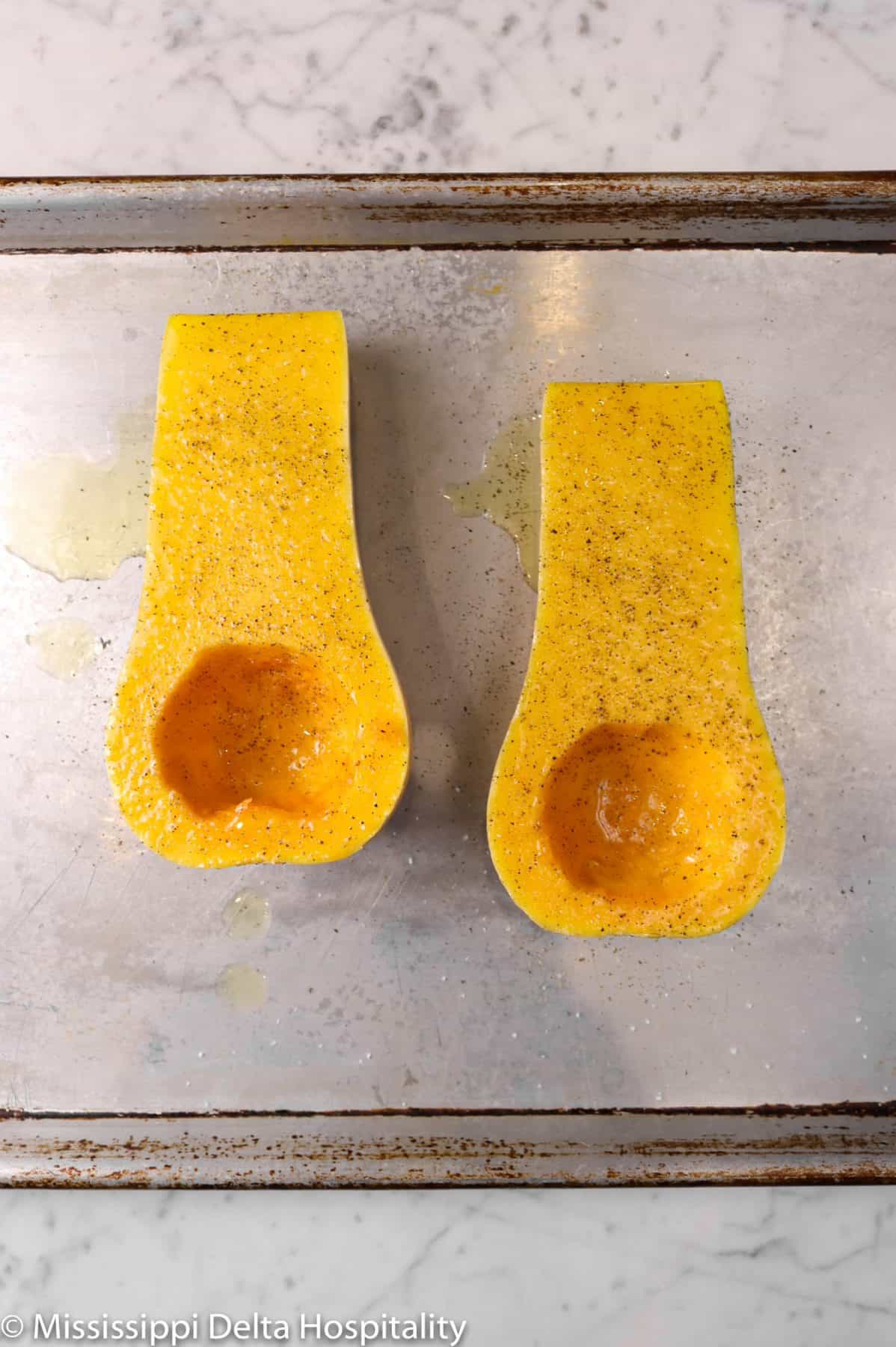 salt and pepper added to butternut squash halves