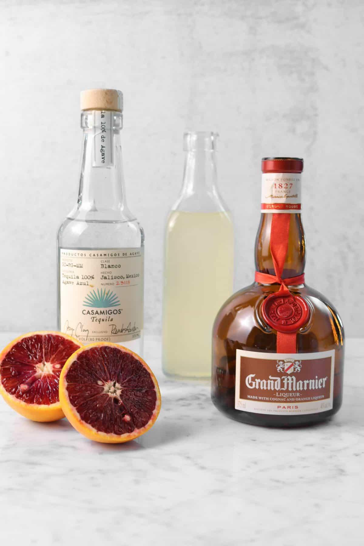 ingredients for blood orange margarita on a marble board