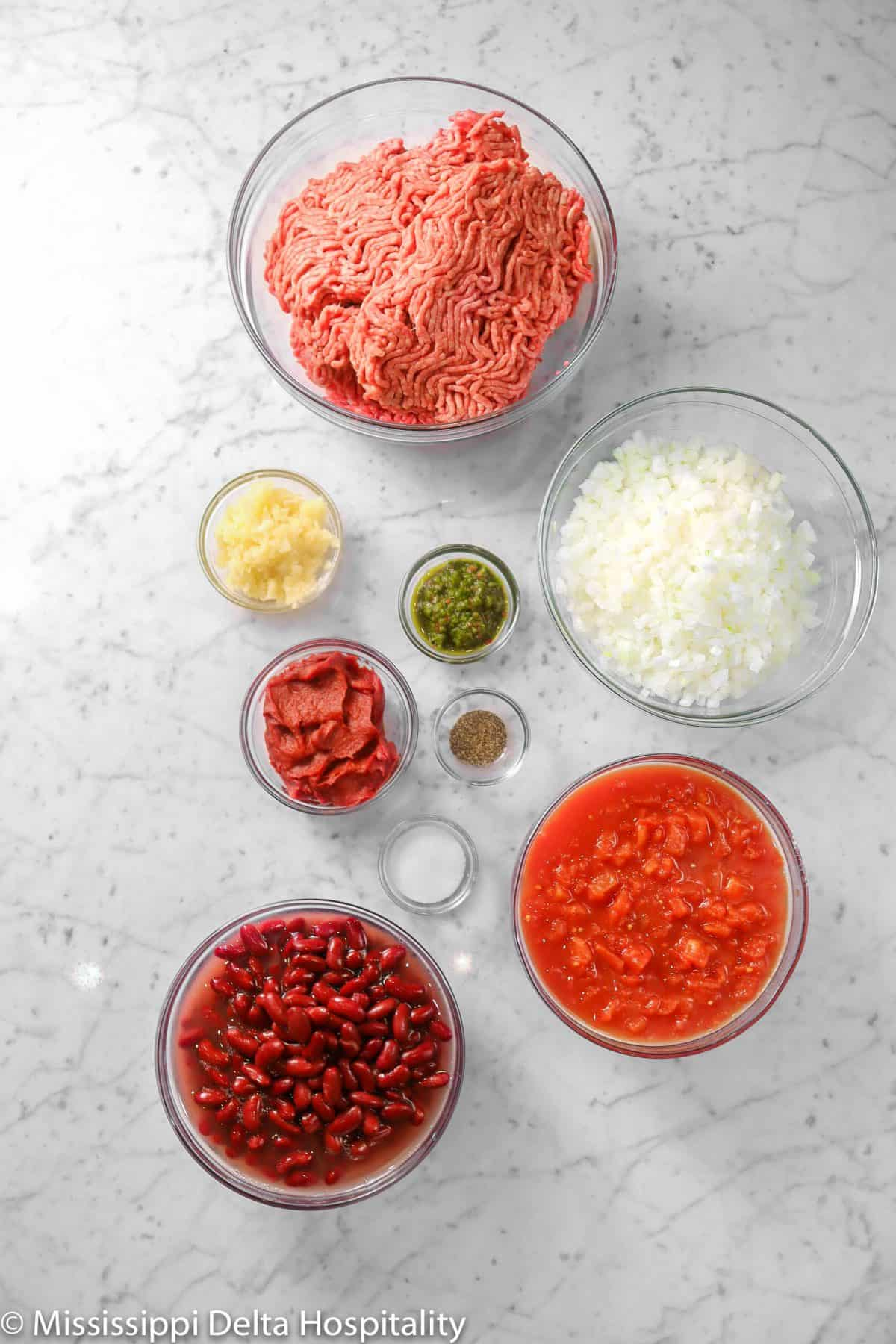 ingredients for chili on a marble table
