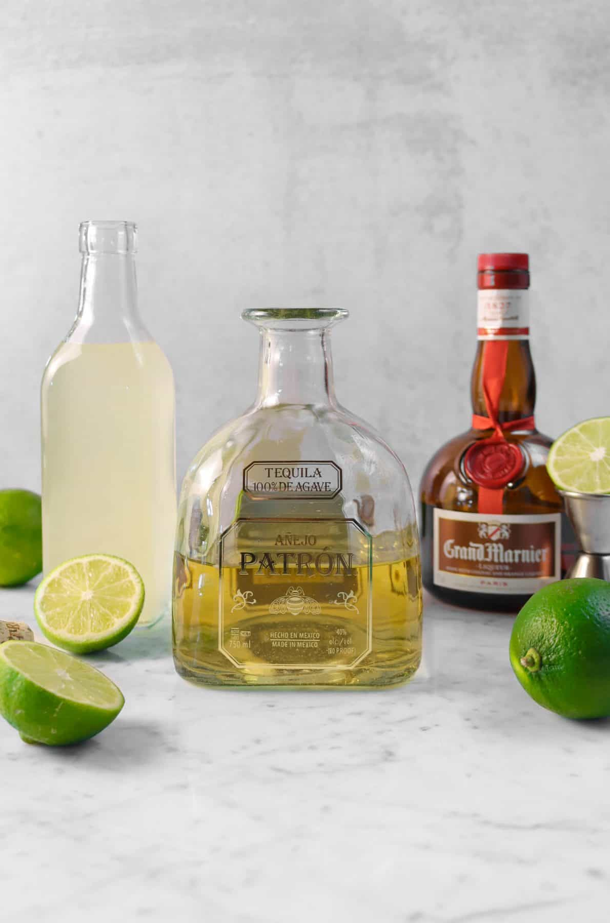 ingredients for a lime margarita on a marble board