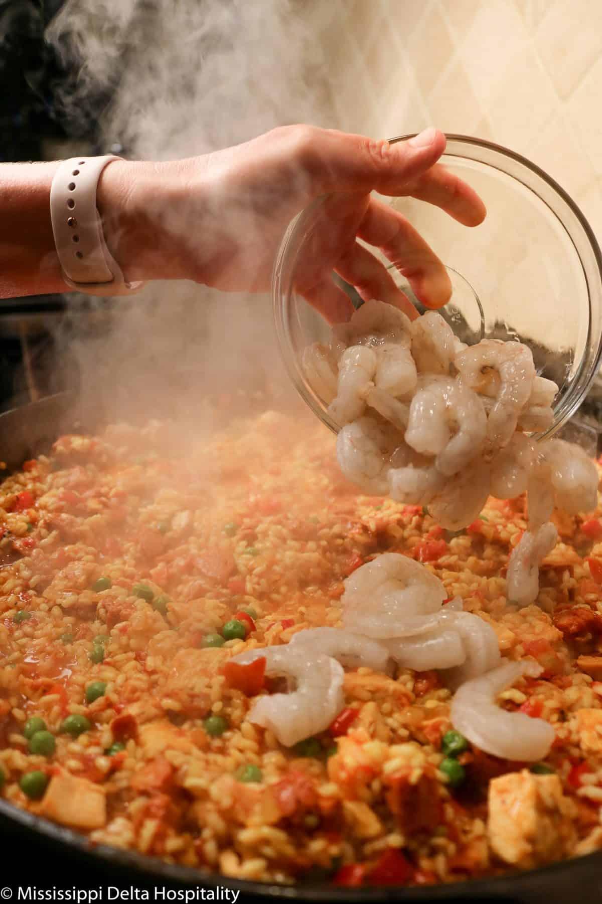 shrimp added to paella