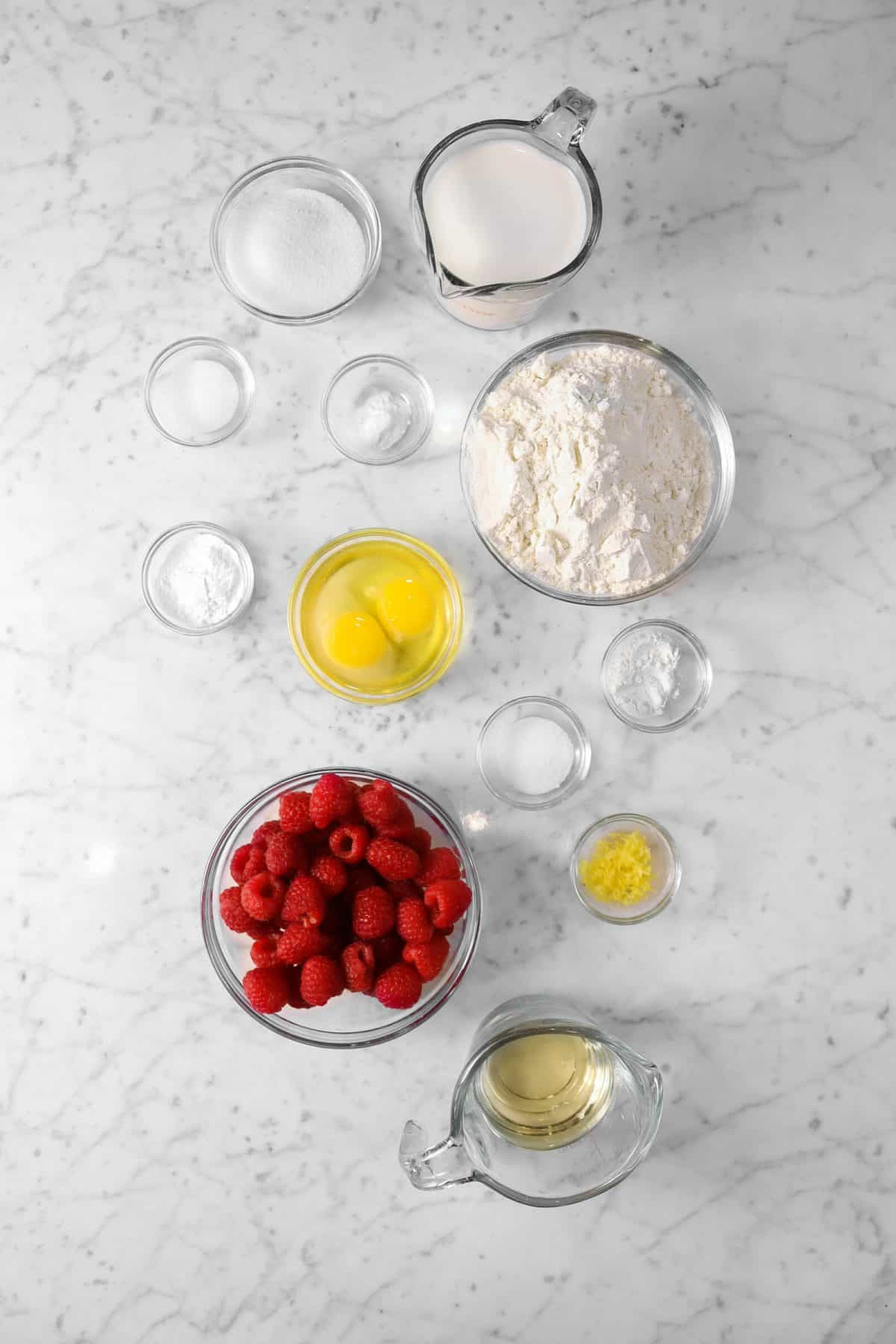 Ingredients for raspberry muffins on a marble table