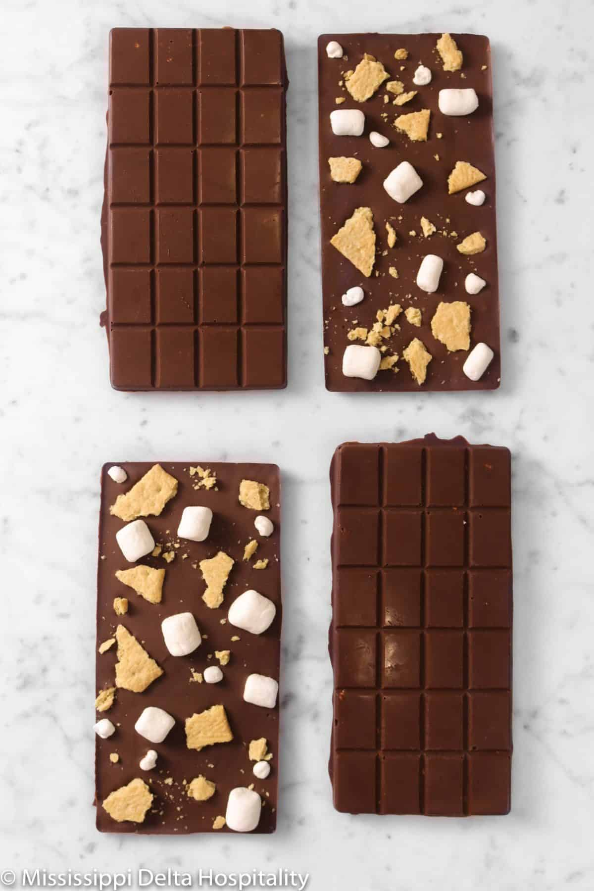 four chocolate bars on a marble board