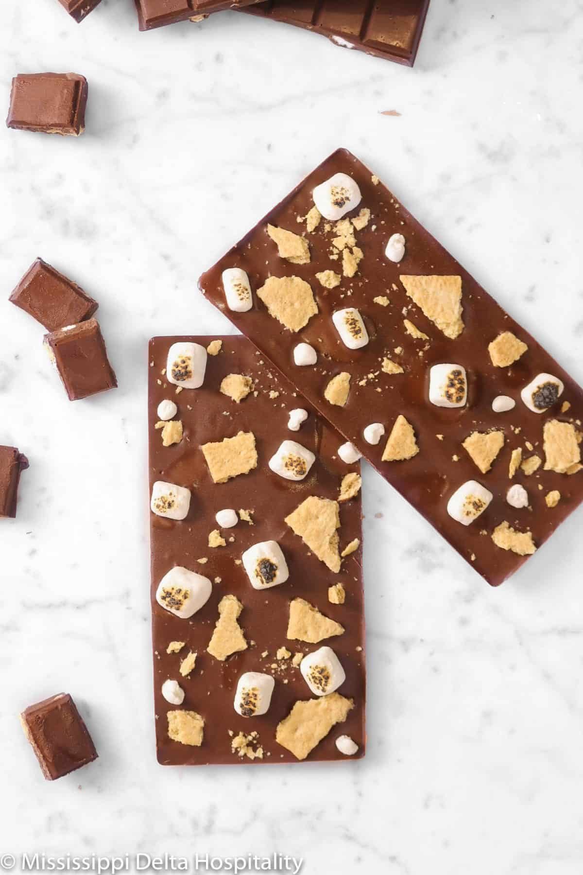 two homemade chocolate bars on a marble table
