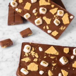 four homemade chocolate bars with marshmallows and graham crackers