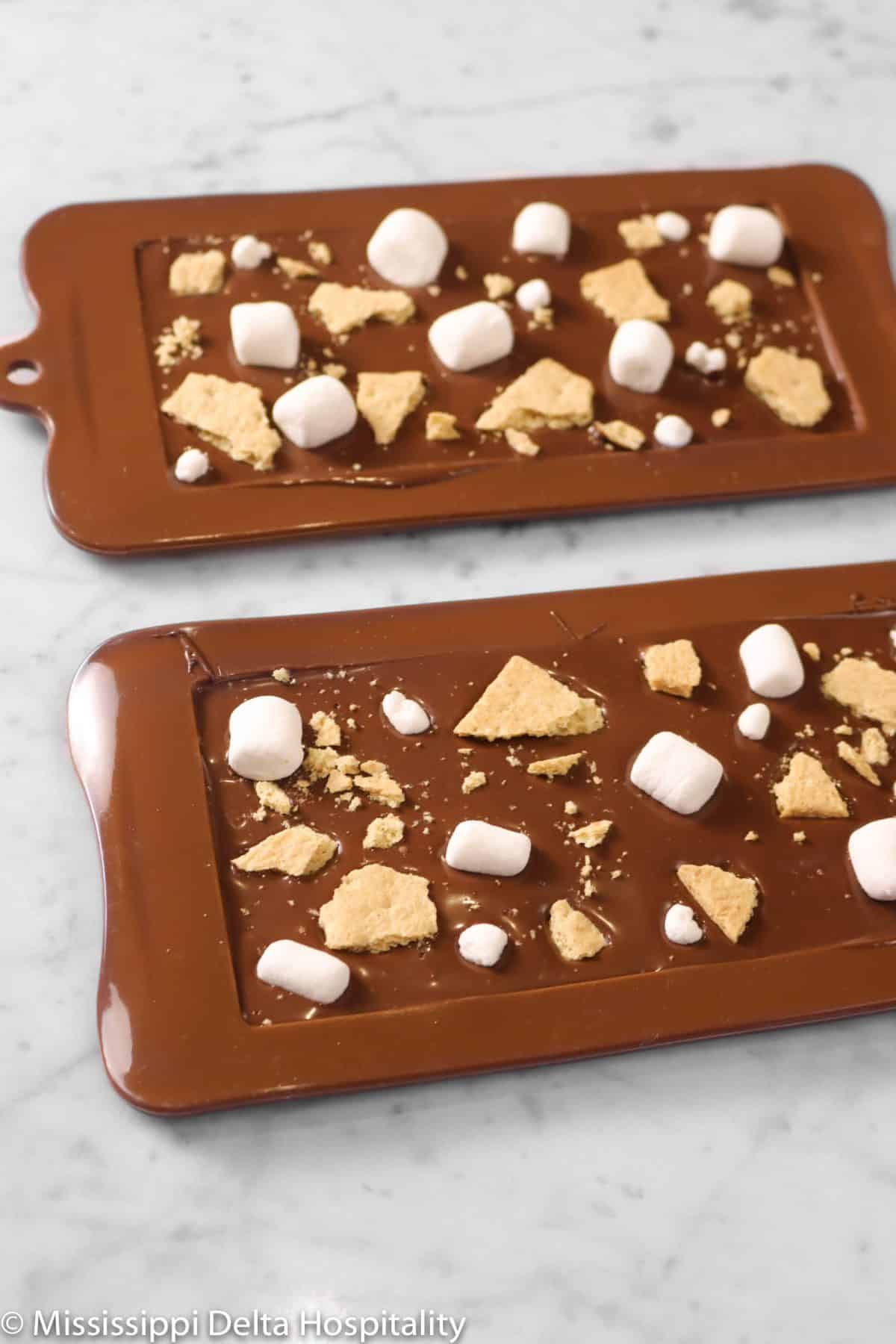 s'mores chocolate bars in molds on a marble table