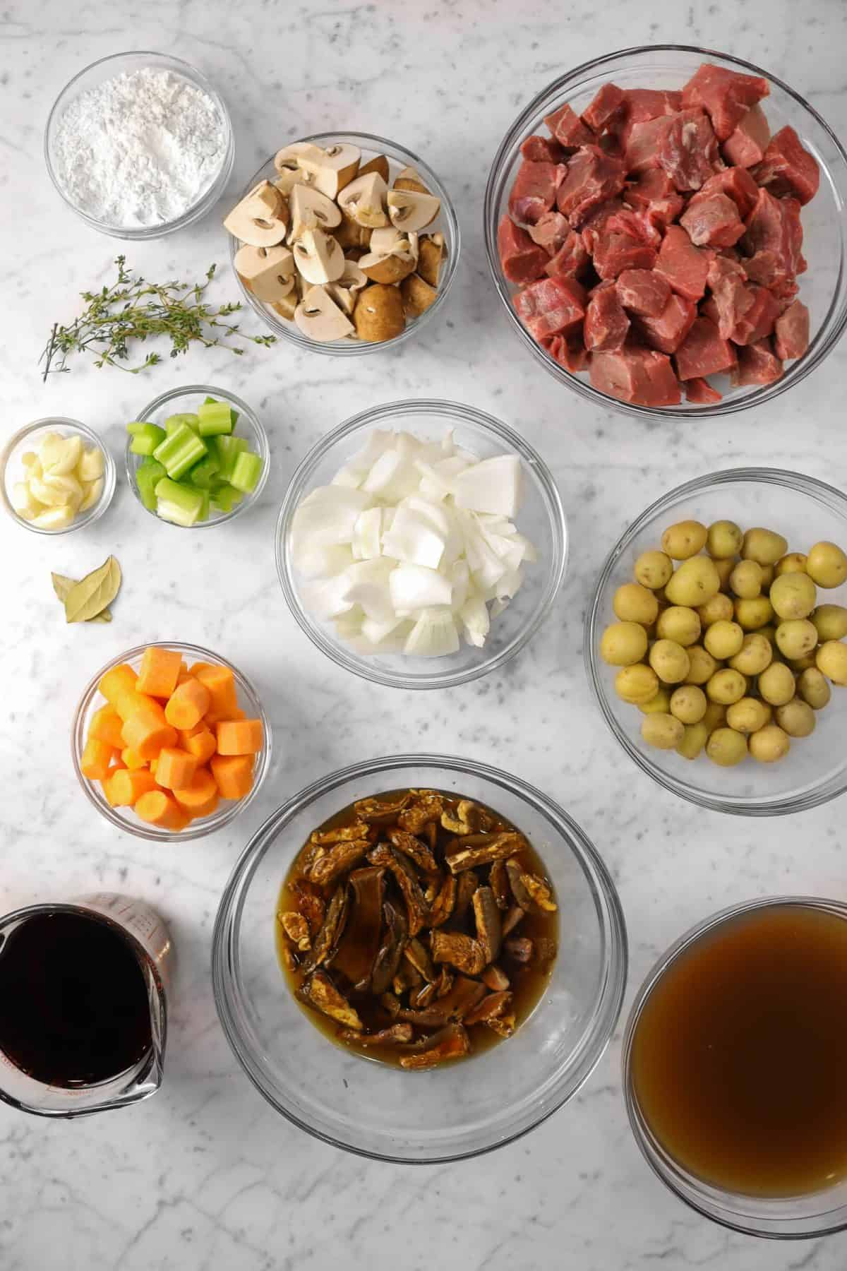 ingredients for beef stew on a marble table