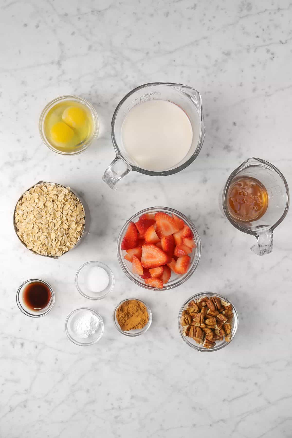 ingredients for strawberry oatmeal bake on a marble counter