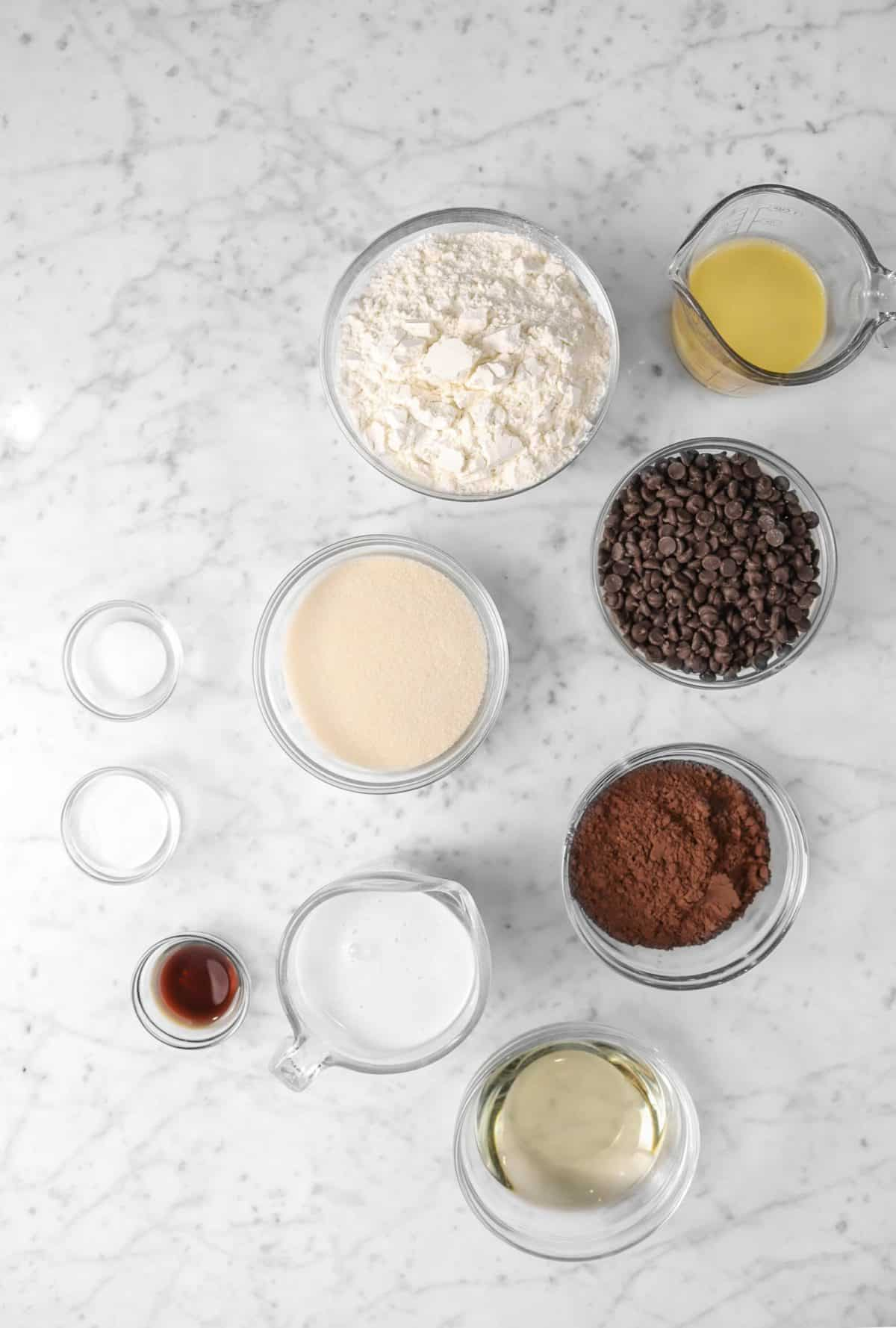 ingredients for vegan chocolate muffins on a marble counter