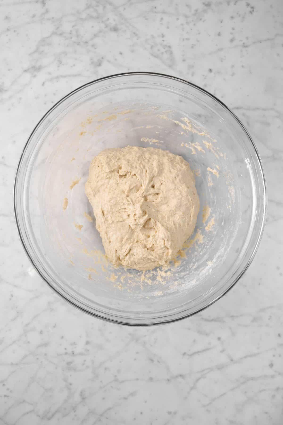sourdough dough in a glass mixing bowl