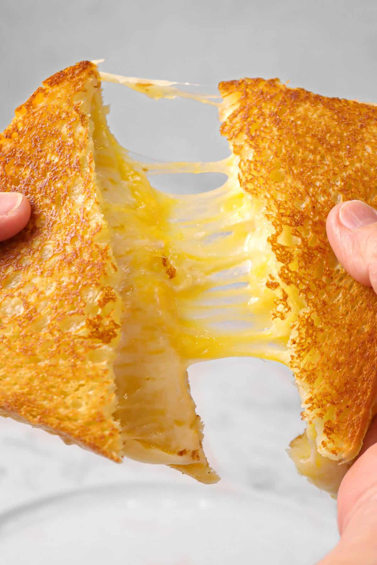 grilled cheese sandwich being pulled apart