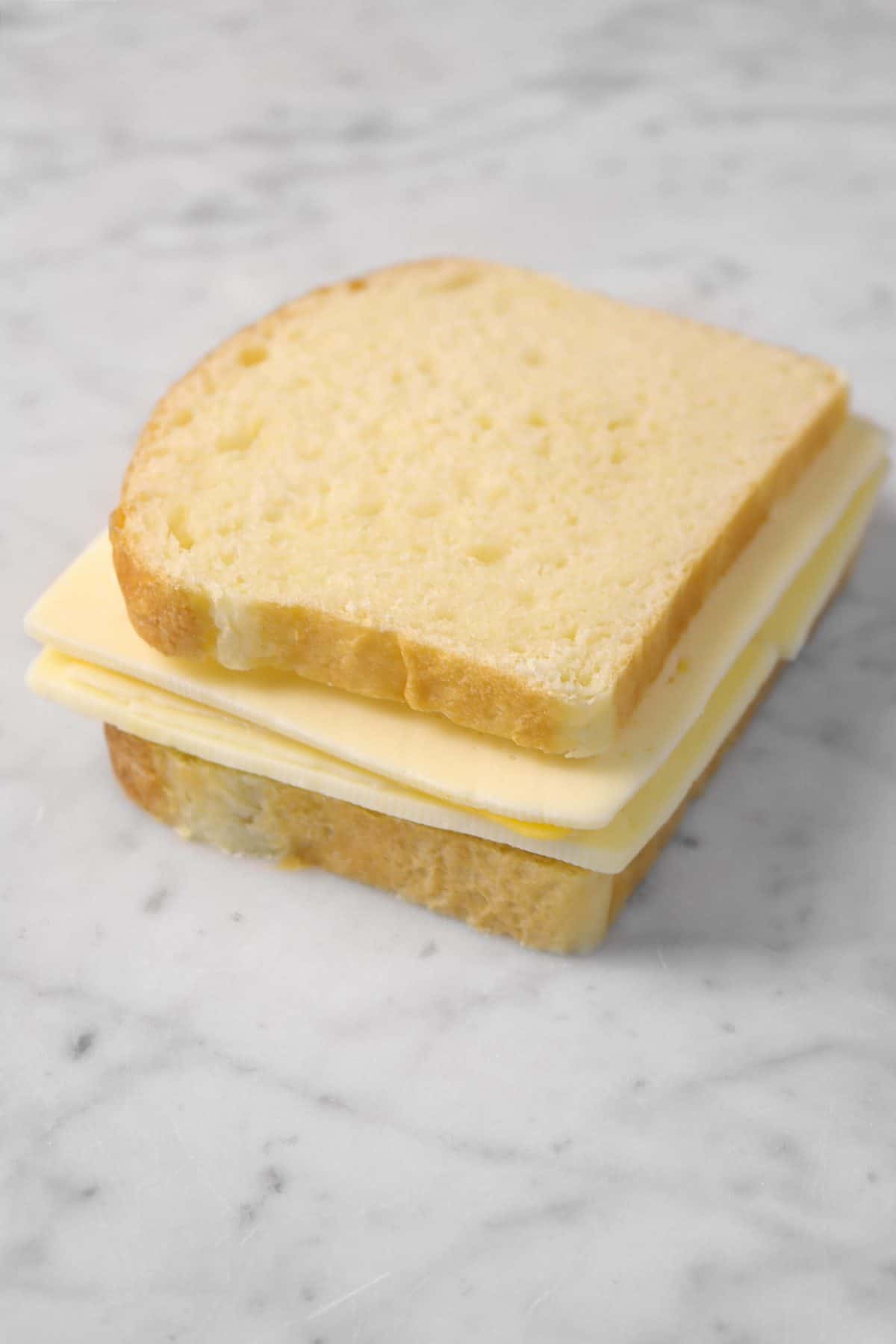 cheese sandwich on a marble board
