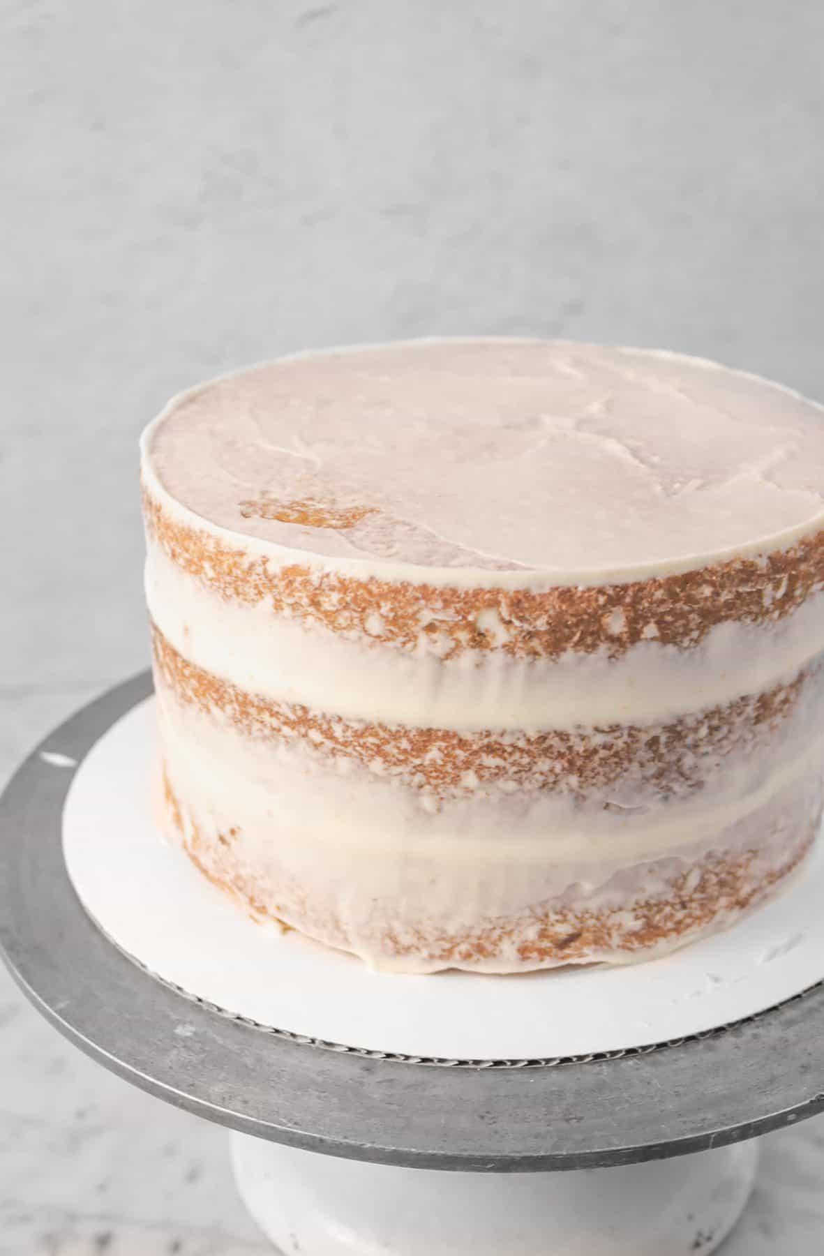 semi naked italian cream cake on a turn table