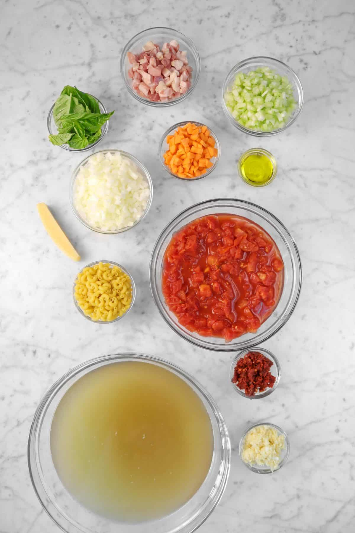 ingredients for minestrone on a marble counter