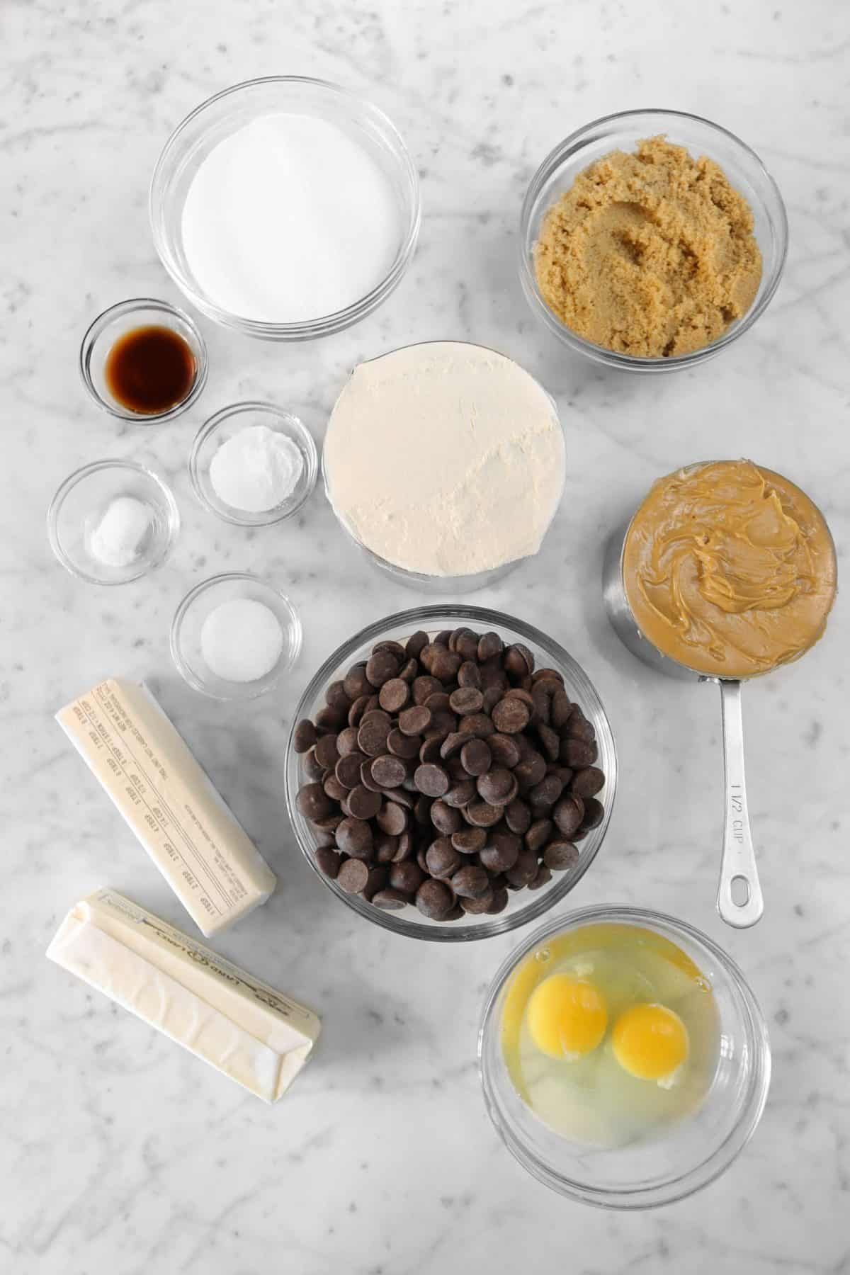 ingredients for peanut butter and chocolate chip cookies on a marble counter