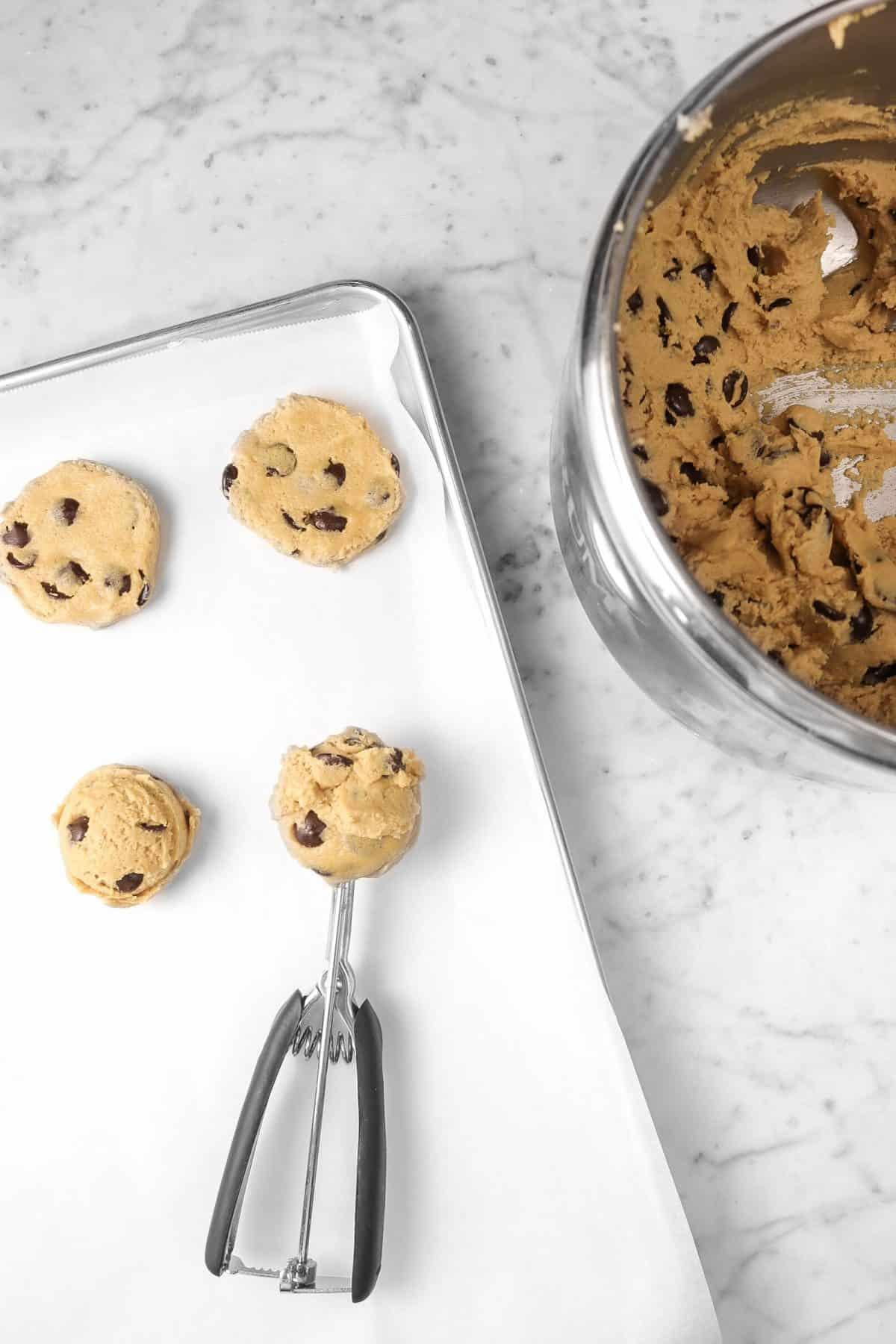cookies being scooped onto cookie sheet