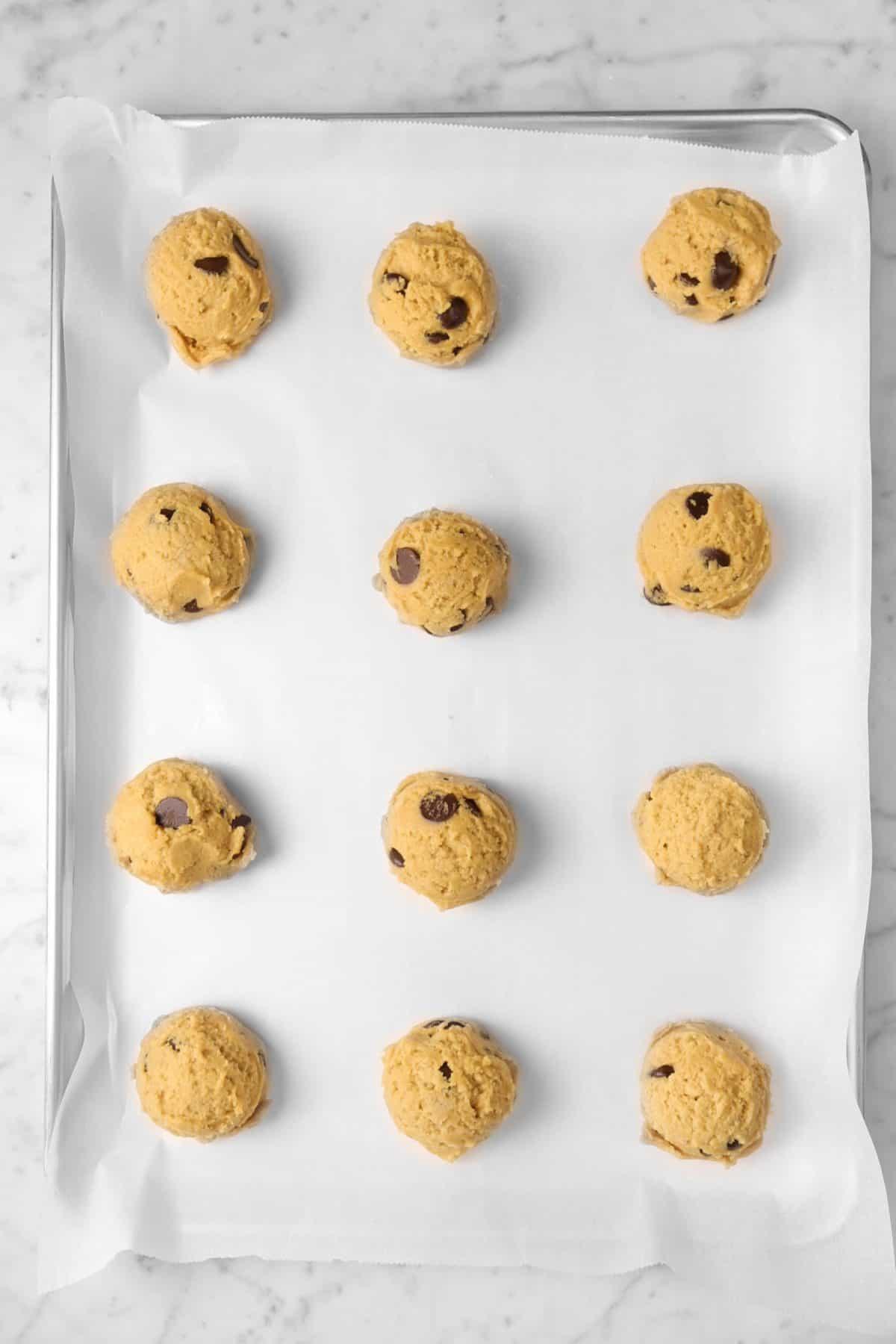 peanut butter cookie dough on a baking sheet