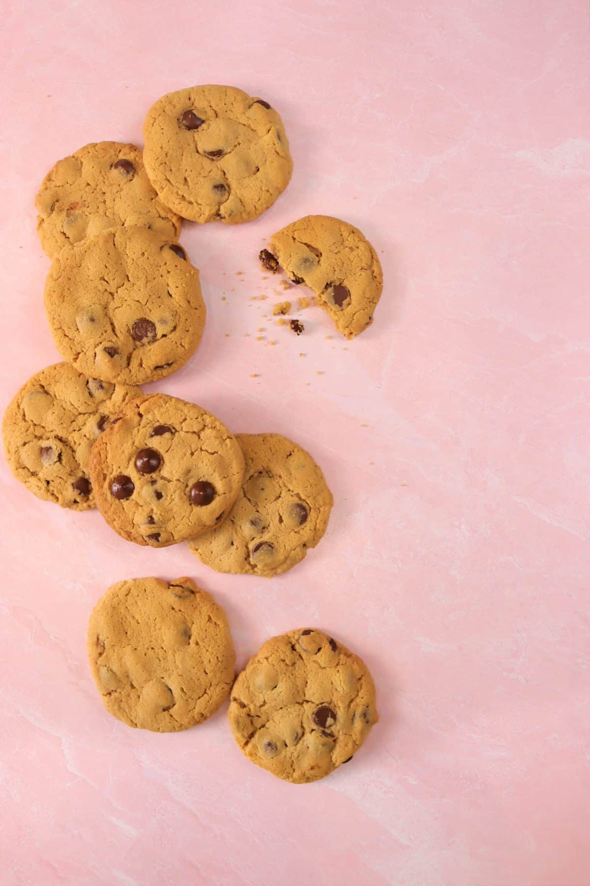 peanut butter and chocolate chip cookies laid out on a pink marble board