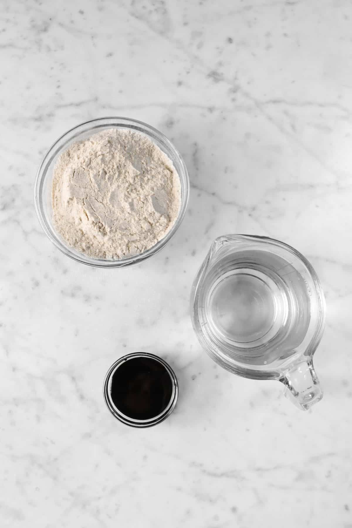 ingredients for sourdough starter on a marble counter