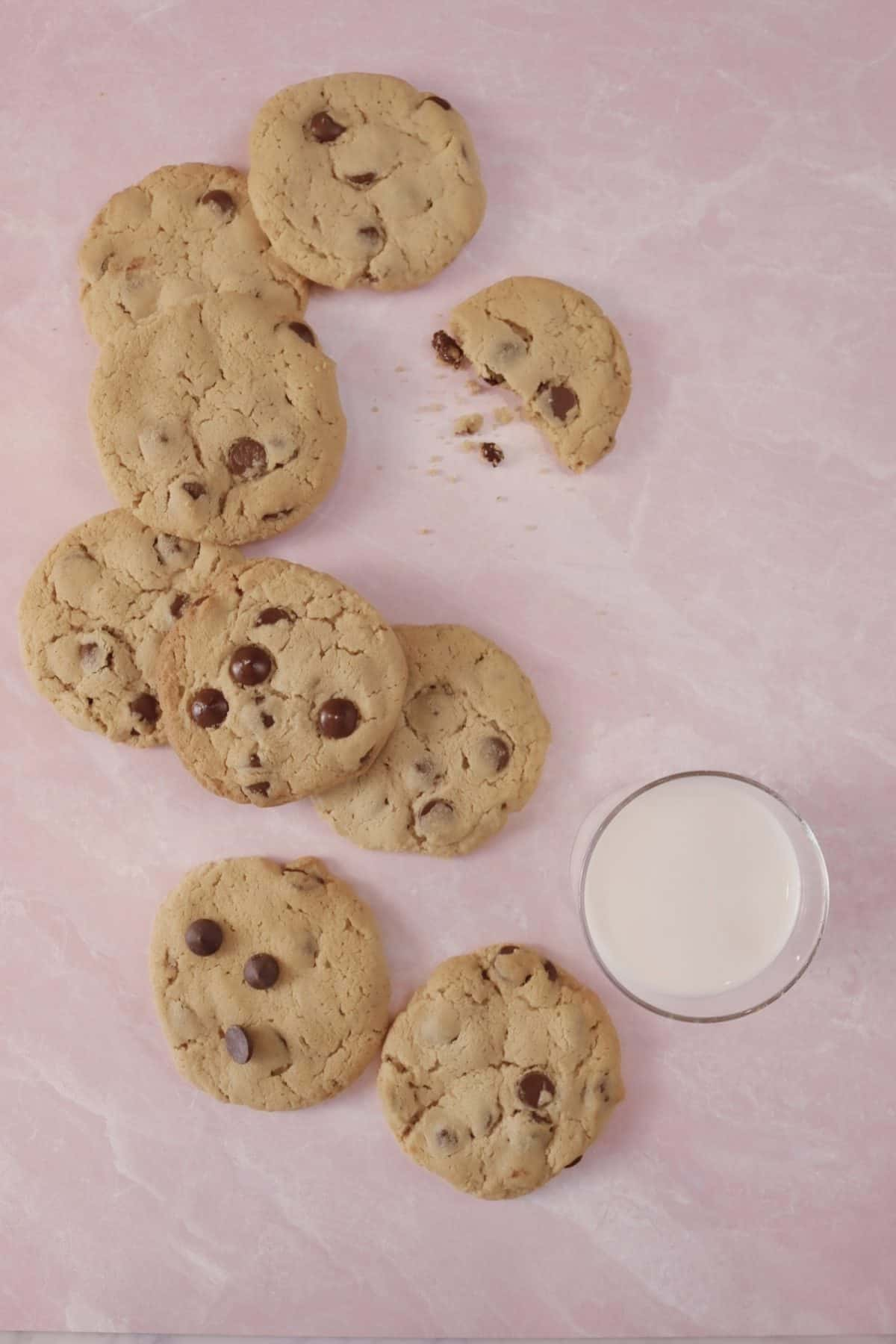 peanut butter chocolate chip cookies on a pink marble board