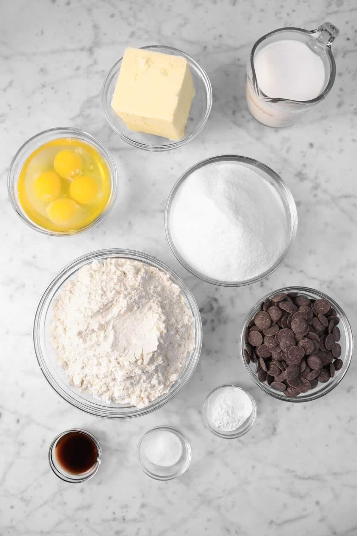 ingredients for chocolate marble pound cake on a marble counter