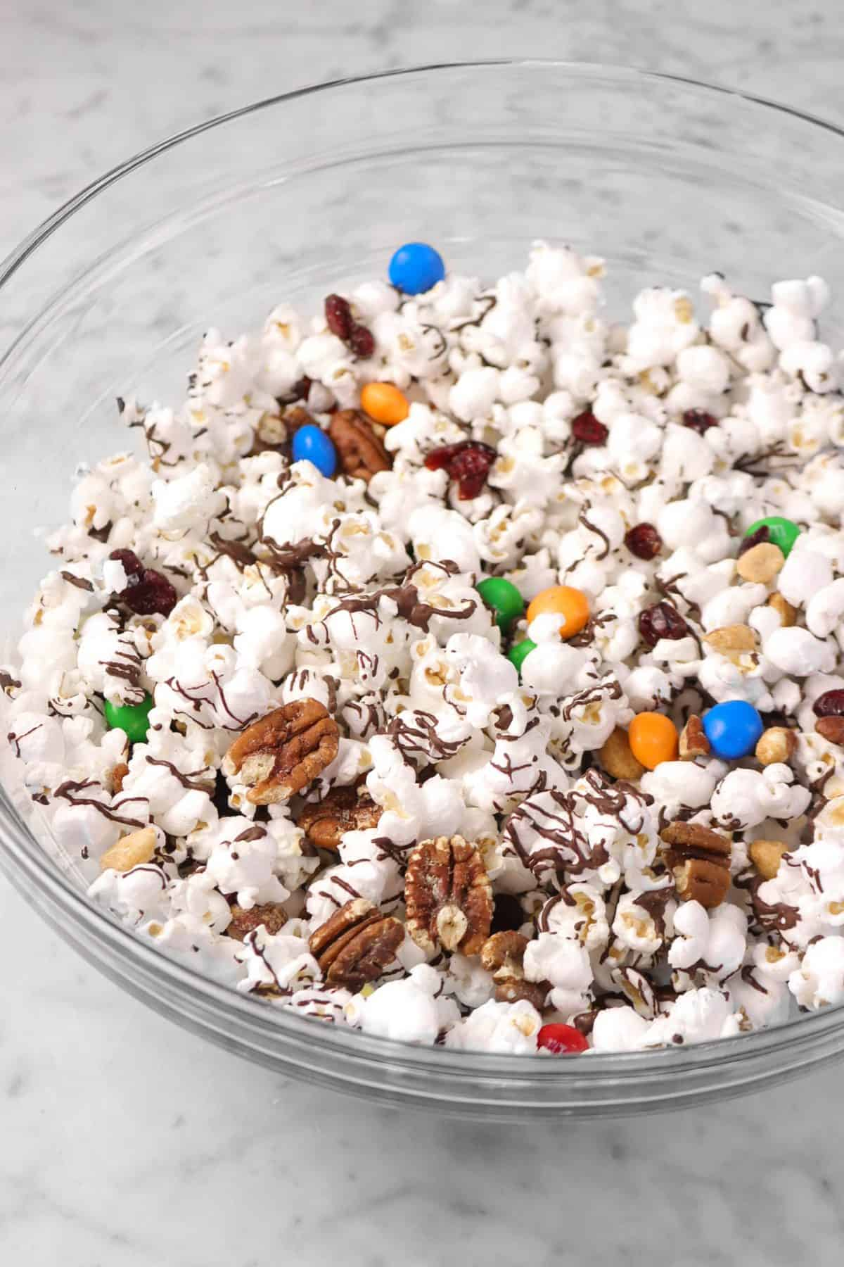 popcorn mix in a glass bowl