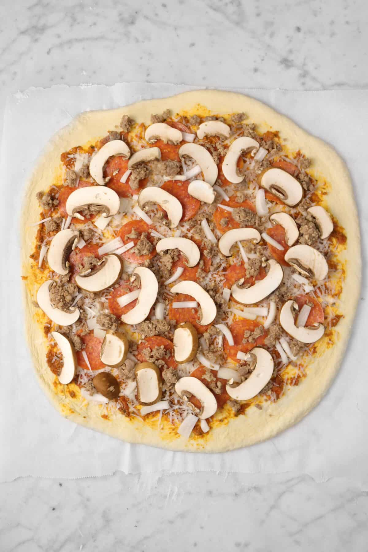 sliced mushrooms added on top of pizza