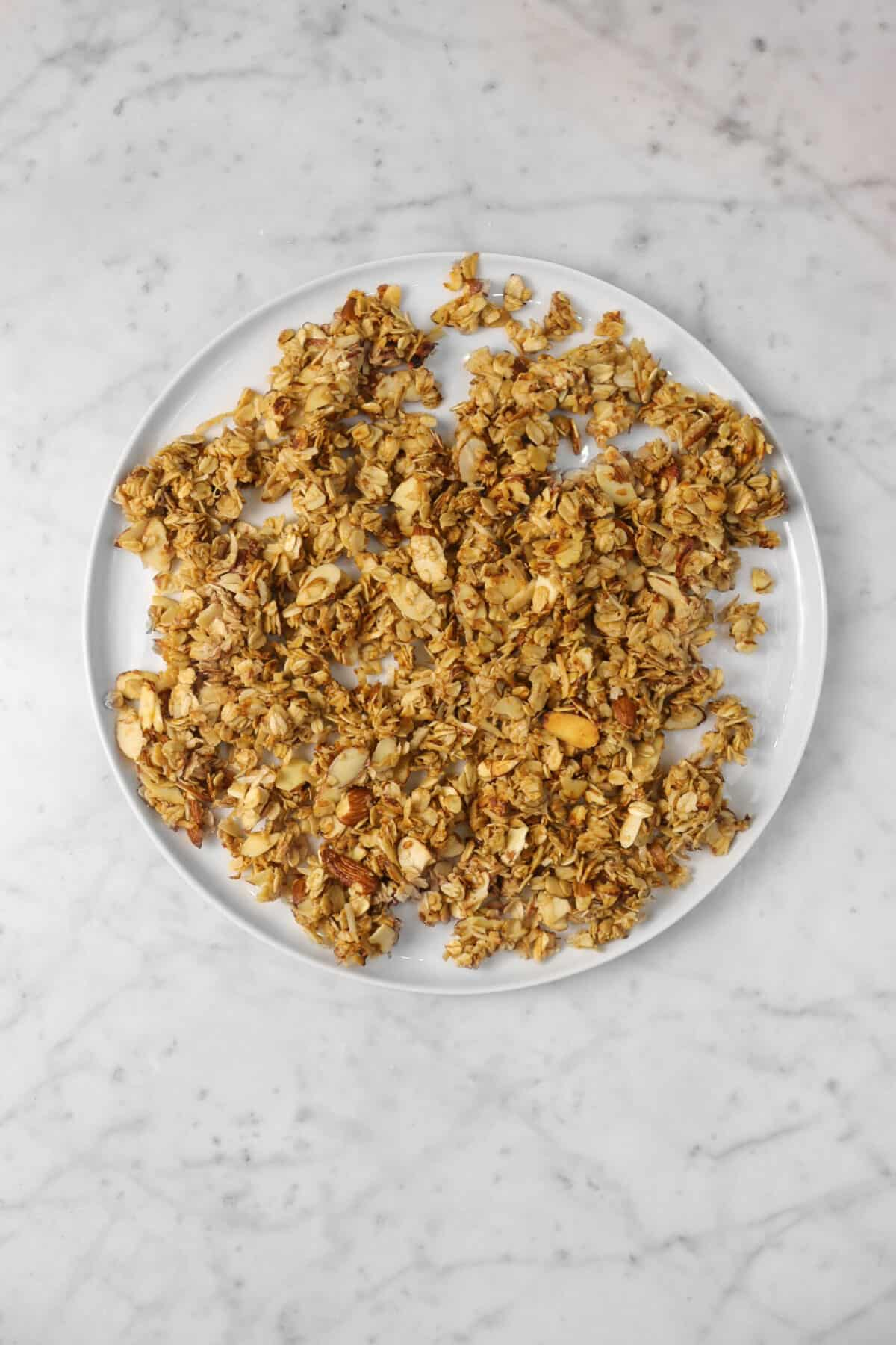 granola spread out on a large white plate