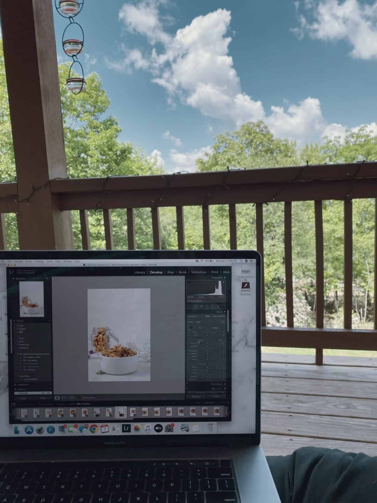 computer with photo of granola open with blue skies and trees in the background