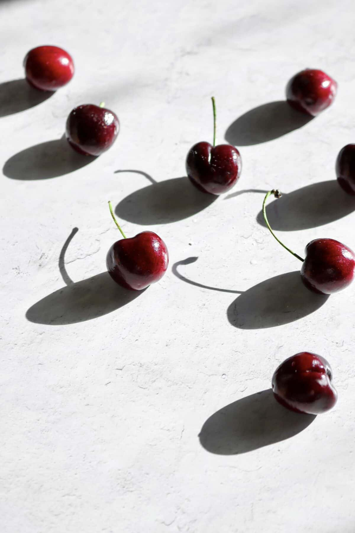cherries on a concrete board