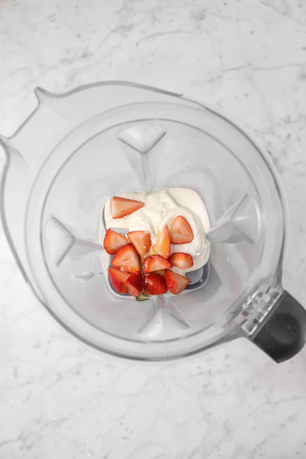 yogurt, honey, and strawberries in a blender