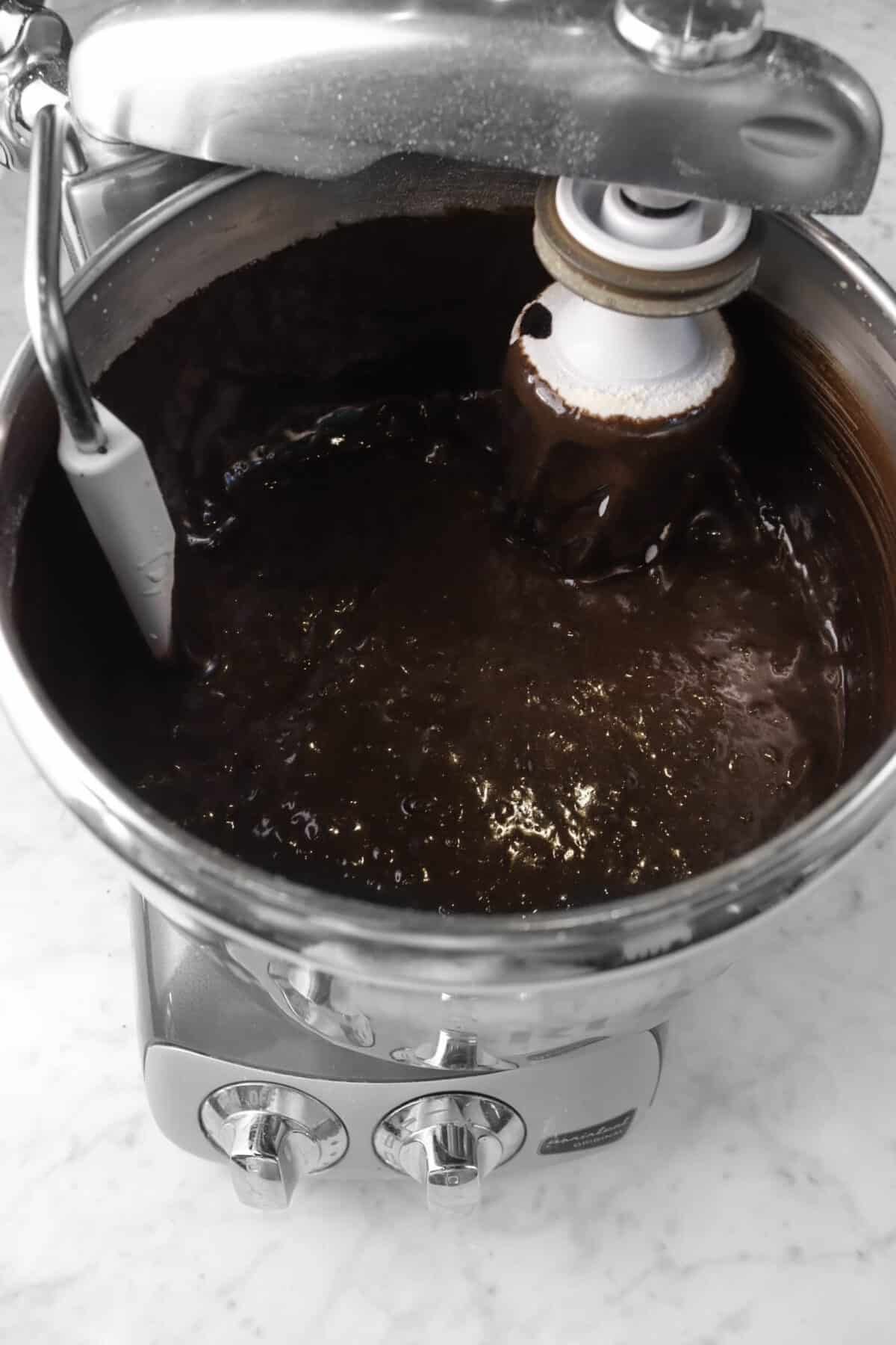 flour mixed into brownie batter in a mixer bowl