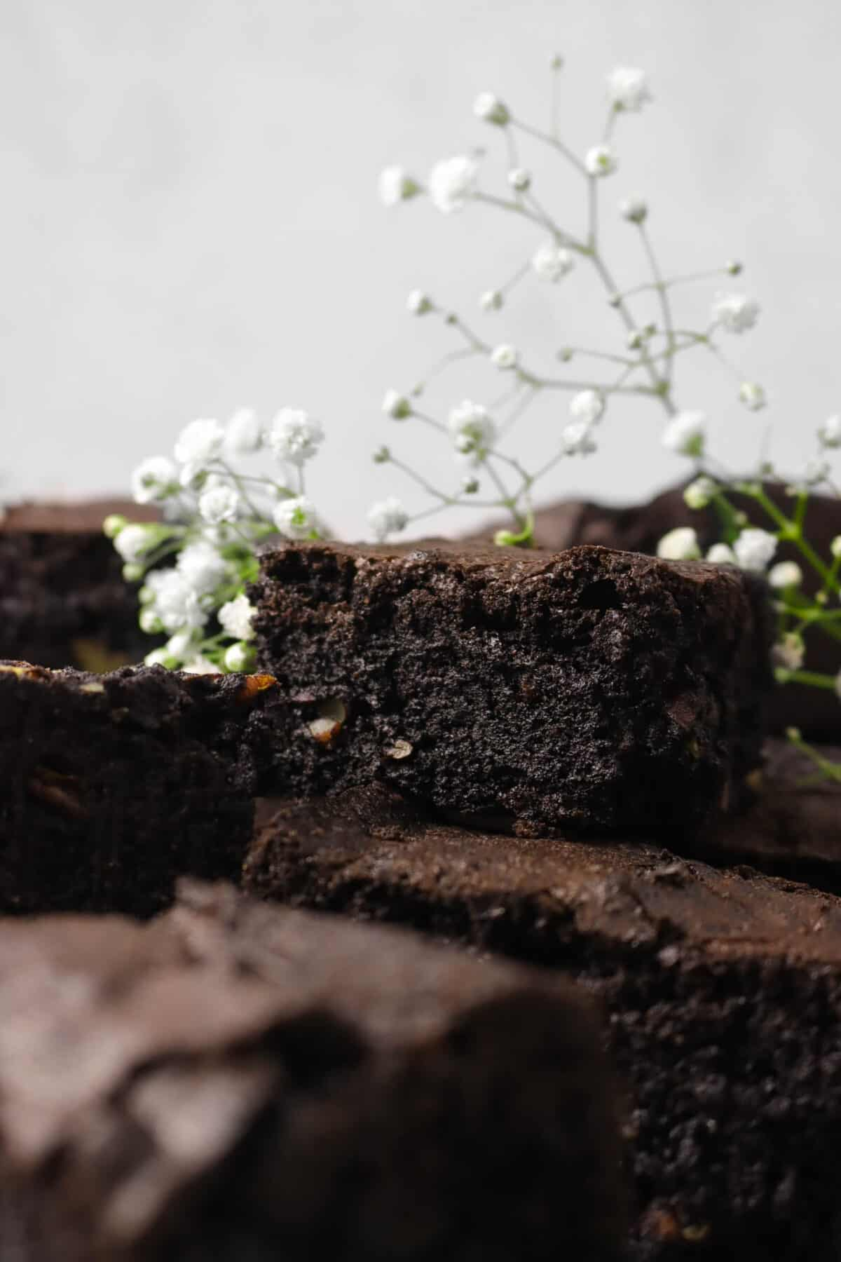brownies stacked on each other with white flowers